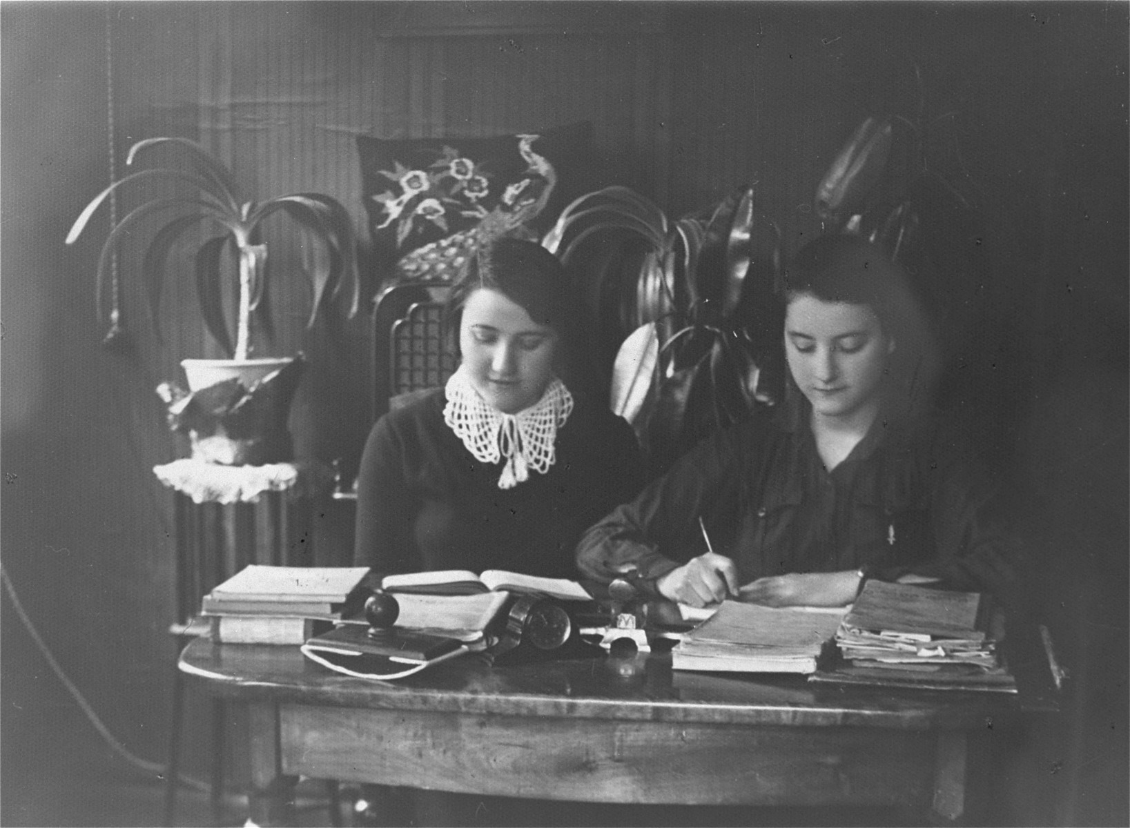 """Two young women, who were members of the kibbutz hachshara Hakovesh, work as secretaries in an office.    They inscribe the photograph to their friend Eliezer Kaplan: """"In memory of the days that we spent together in kibbutz Hakovesh in Taurage..."""""""