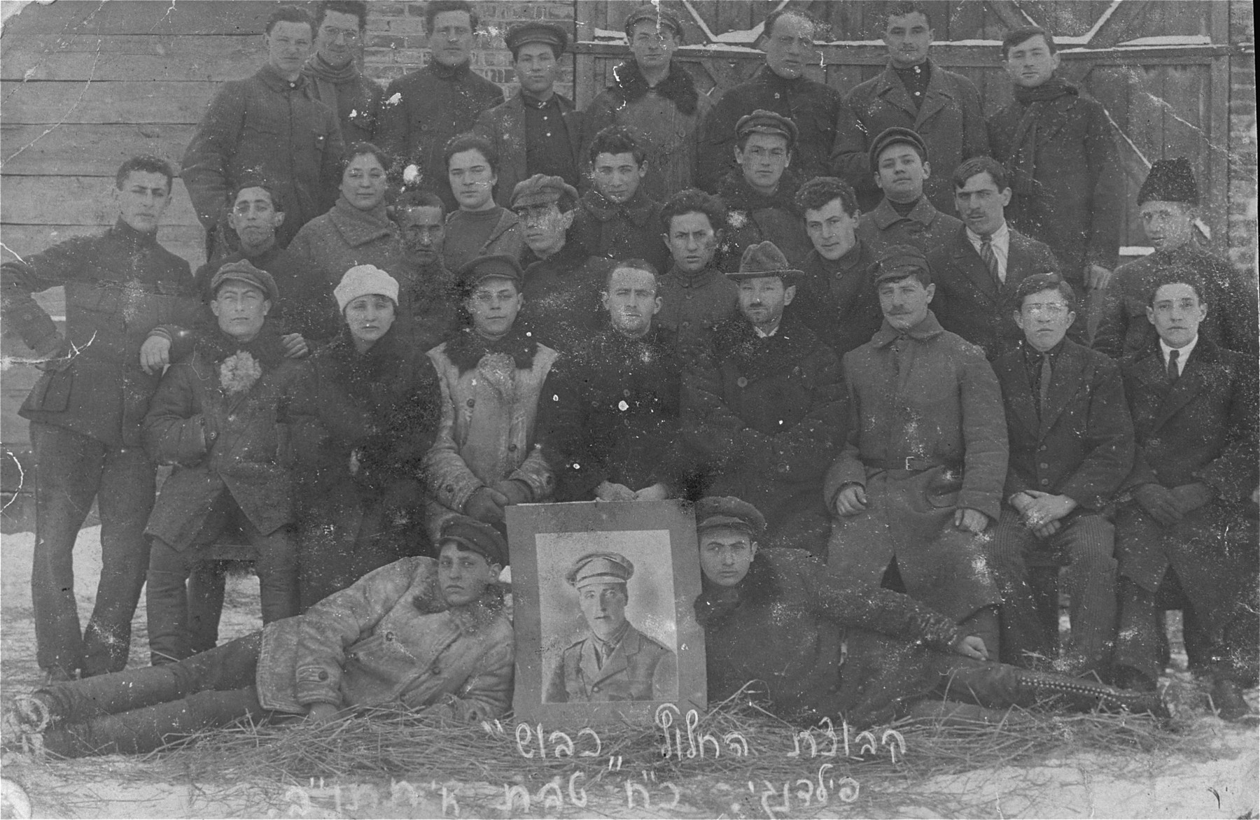 Group portrait of members of the Zionist hechalutz group, Kibbush in Kron, Lithuania.