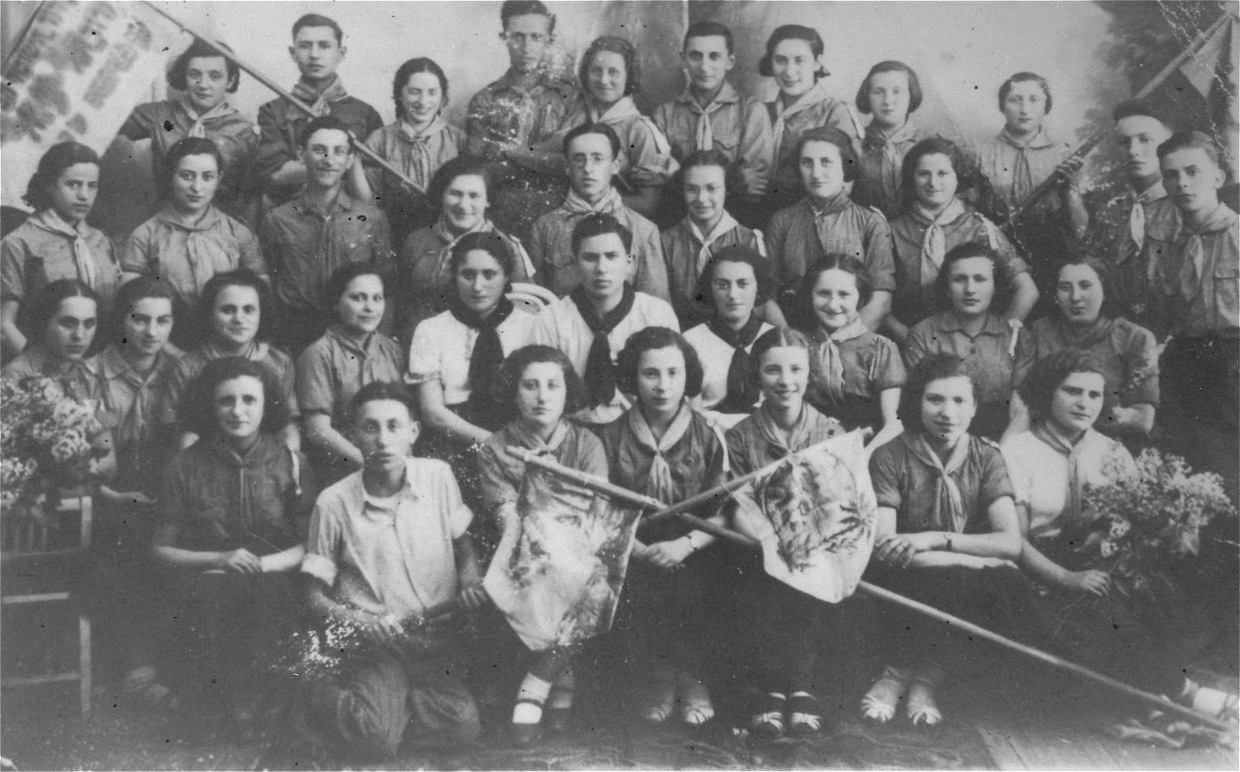 Group portrait of members of the Hashomer Hatzair Zionist youth movement in Ciechanow, Poland, among them Roza Robota.    Pictured from left to right are: Front row: Makovska, Johevet Aurbach, Mondrzak, Regina Mysior, Srebnagora and Lea Altus. Second row: Hinda Lindenberg, unknown, Gitel Kahane, Hinda Kahane, Malka Leventhal, Aba Garfinkle, Ryvka Inwentarz, Pschulka, Lea Schultz and Lea Kirshenbaum. Third row: Makowska, unknown, unknown, Roza Robota, Mileh Zilberstrom, Ruth Kirshenzweig, Malka Shtippenholtz, unknown, unknown and Libel Gogol.  Top row: Pazgorek, Shepsel Galek, Fella Brash, Moishe Schlesinger, Hella Garfinkle, unidentified, Sara Robota, Esther Kostrzeva and Seeza Bronstein.