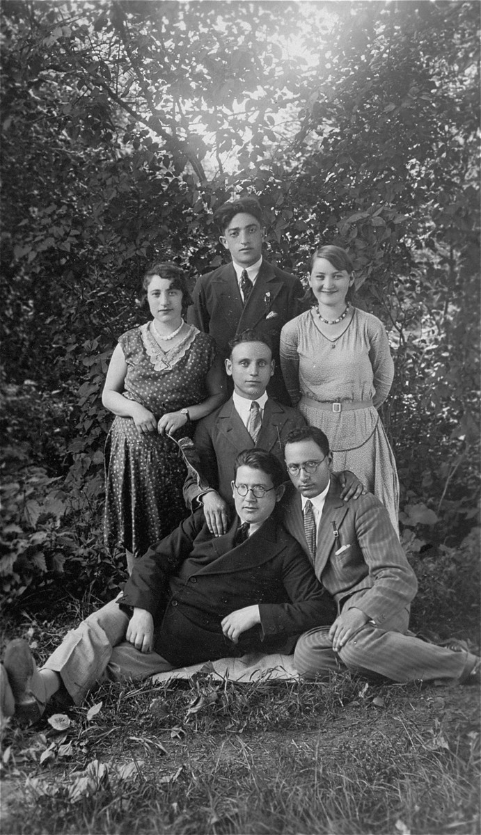Group portrait of young Jewish men and women in Lithuania. Pictured at the top is the donor's father, Eliezer Kaplan.