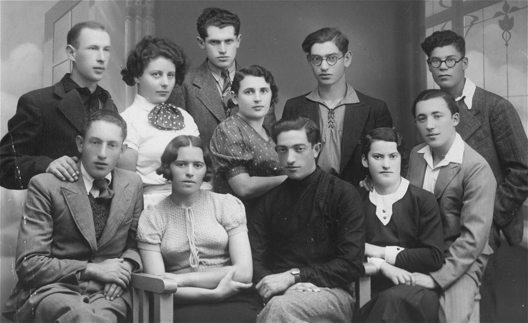 Group portrait of members of a hachshara (Zionist collective) in Lithuania.    Eliezer Kaplan is pictured in the front row, center.