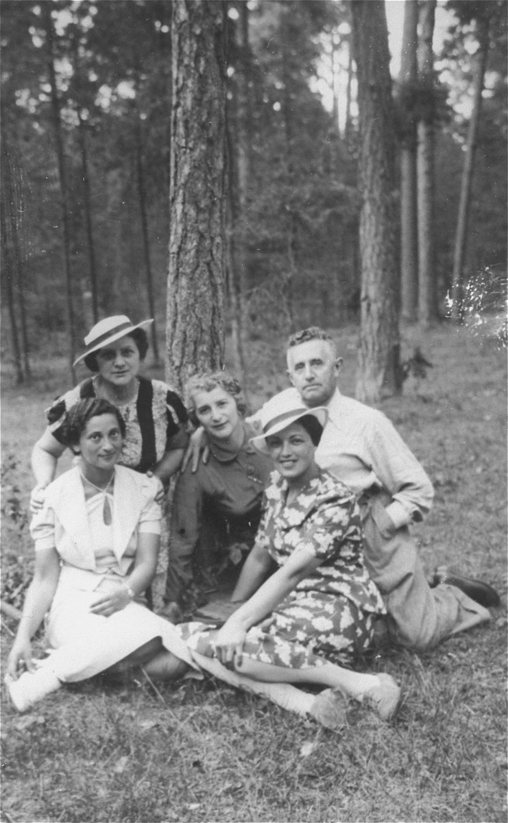 Members of the Bobrow family and friends rest during an outdoor excursion..