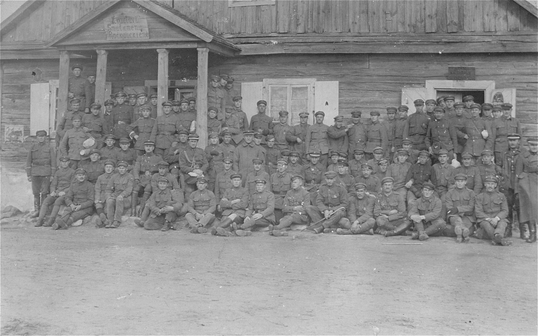 Group portrait of a Lithuanian military unit in front of a house owned by the Gar family in Kron.