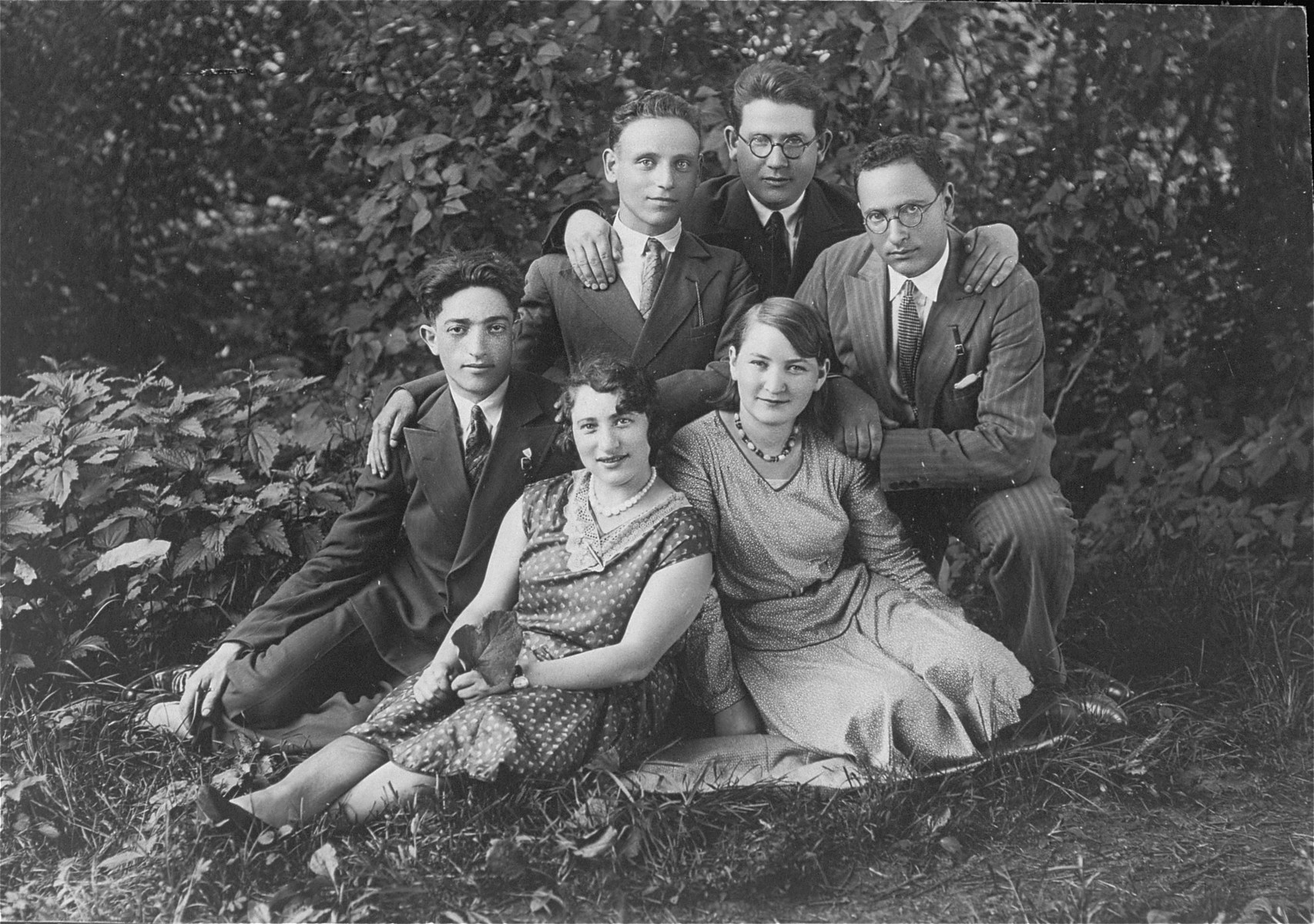 Group portrait of young Jewish men and women in Lithuania. Pictured at the far right is the donor's father, Eliezer Kaplan.