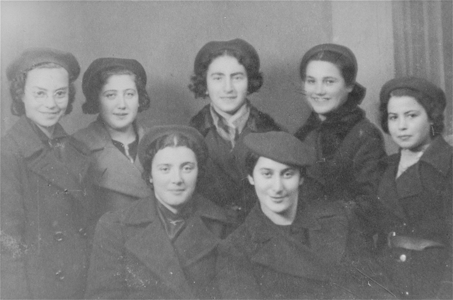 Group portrait of girls in the Hashomer Hatzair Zionist youth movement in Ciechanow.  Pictured in the front row from left to right are: Chana Pazgorek and Sara Robota.  Standing in the back row from left to right are: Ruchcha Kirshenzweig, Jochevet Aurbach, unknown, Hinda Levinthal and Hena Grynbaum.  Jochevet, Hinda and Hena all perished in Auschwitz.