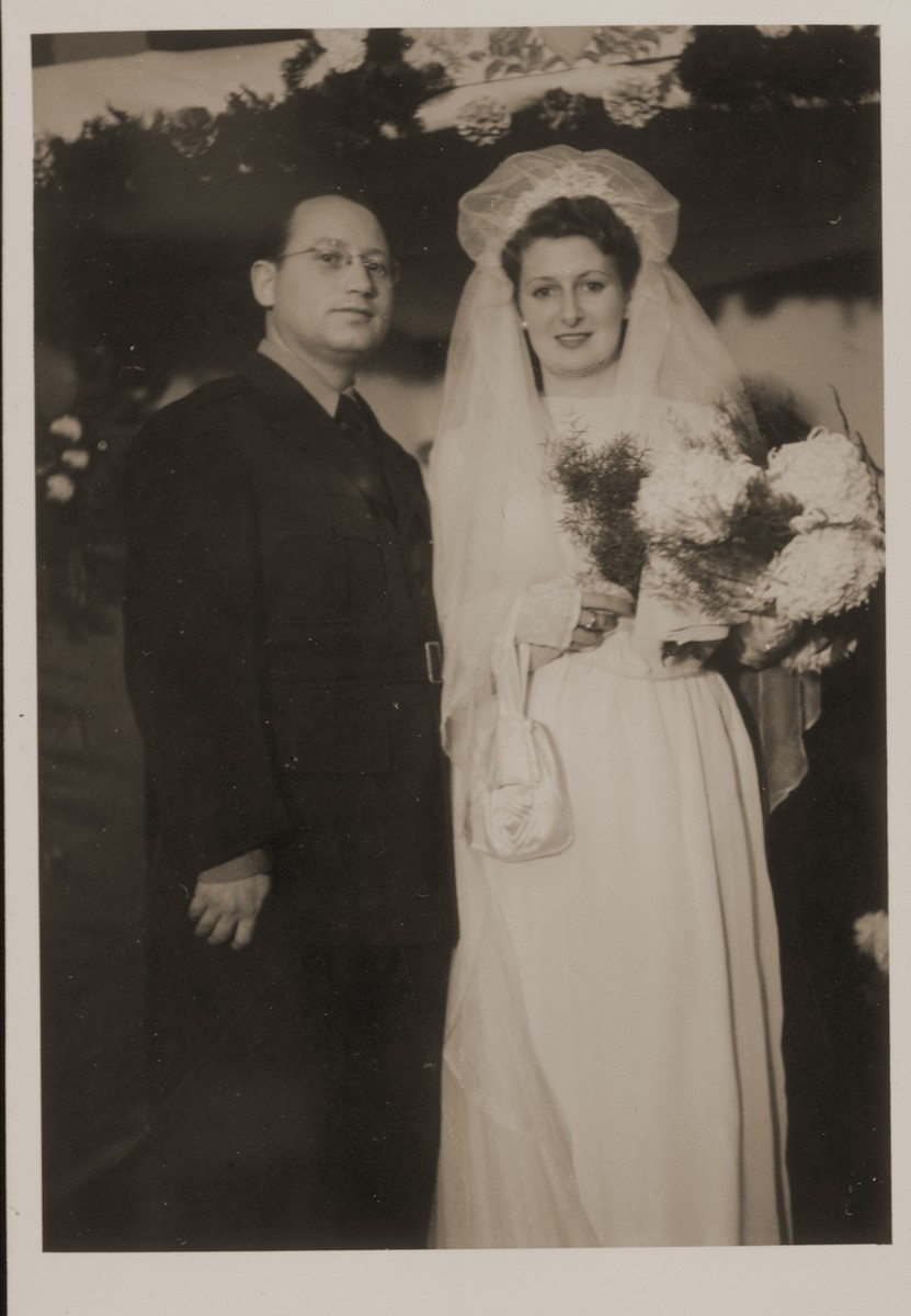 Portrait of a Jewish couple on their wedding day in Passau, Germany.  Pictured are Rabbi Morris Fishman and Lala Weintraub.