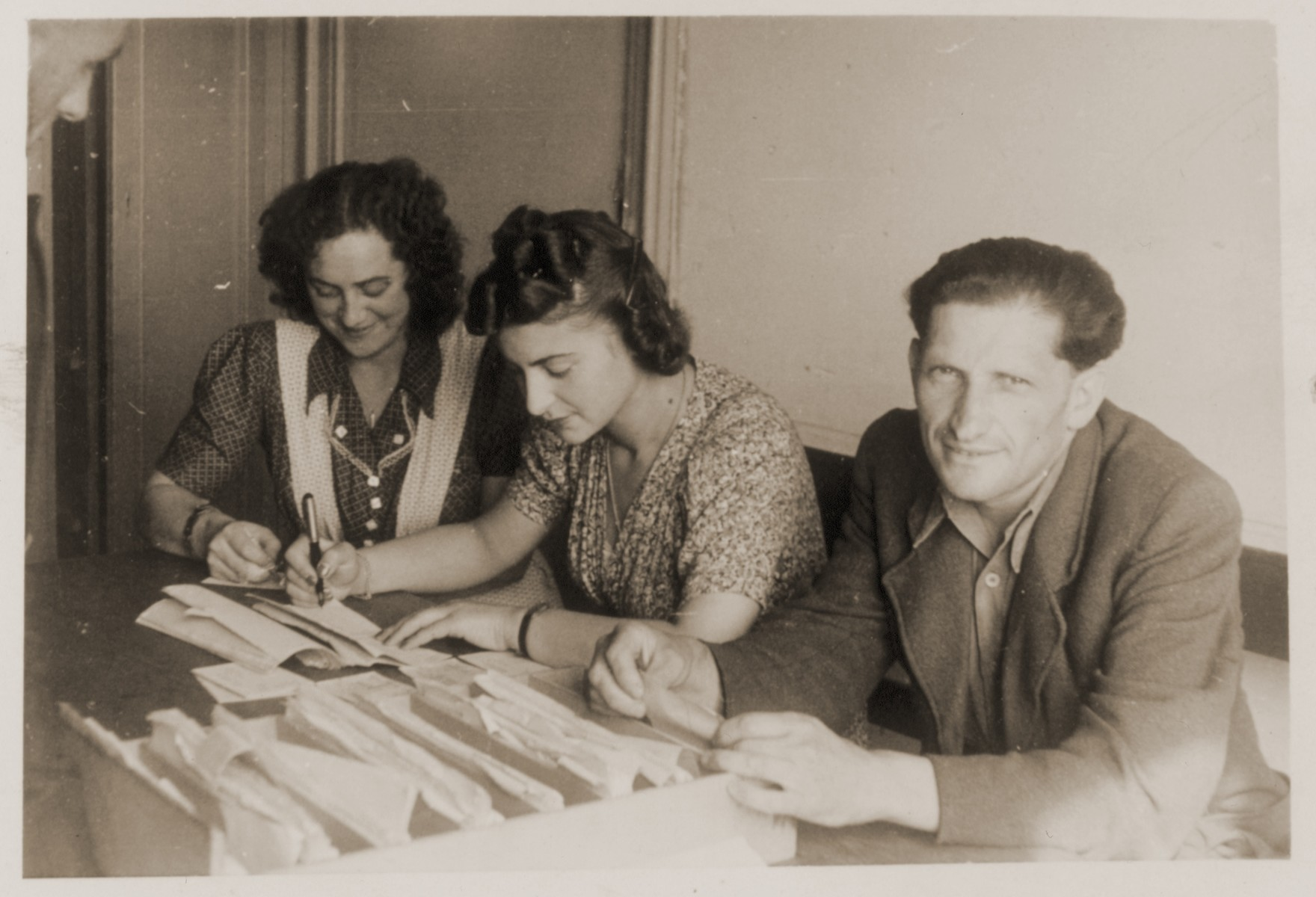 Jewish DPs work at a table outside the employment office at the Schlachtensee displaced persons camp.