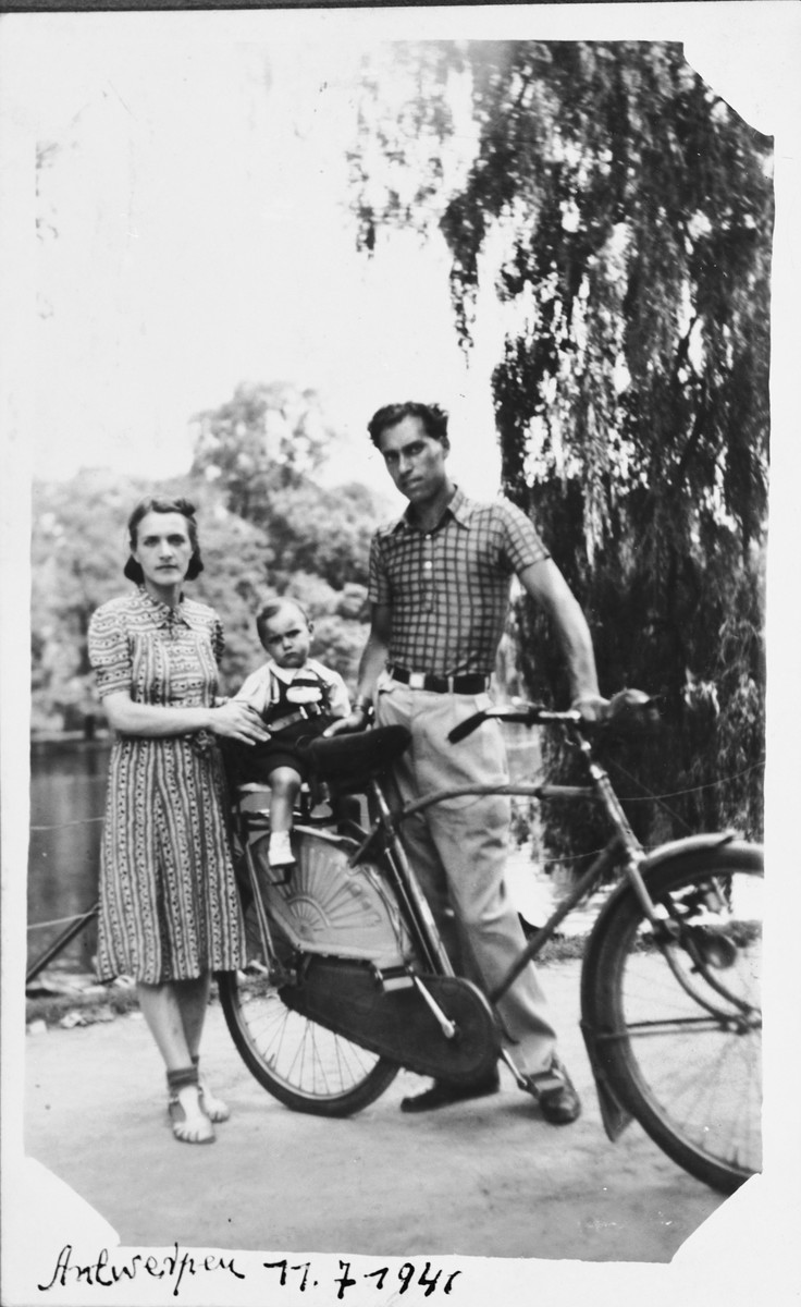 A young Jewish couple takes their baby for a bicycle ride in Antwerp, Belgium.  Pictured are Alex and Leah Ciechanow with their son Nathan (Nounou).  The family was subsequently deported to Auschwitz, where Leah and Nathan were killed.