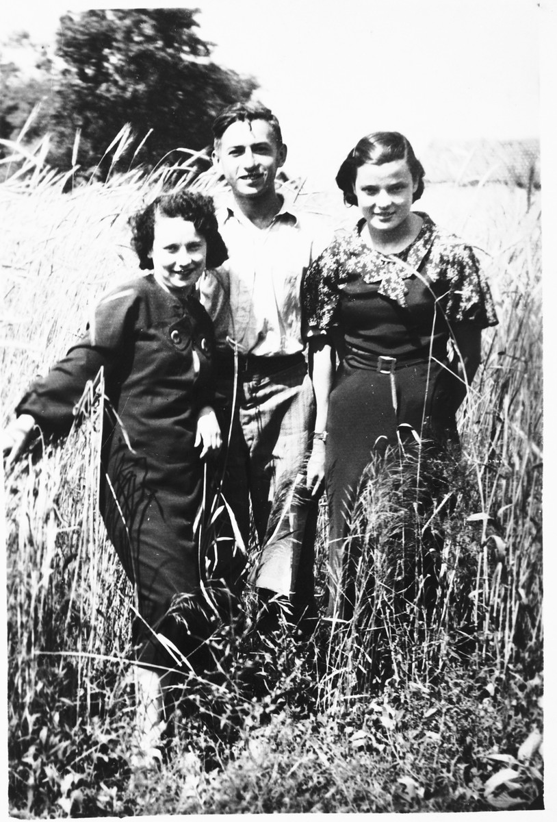 Faigel Lazebnik poses in a field near her home with two friends.  Faigel is on the far left.  Also pictured are Abramovitch and Sienkewicz.