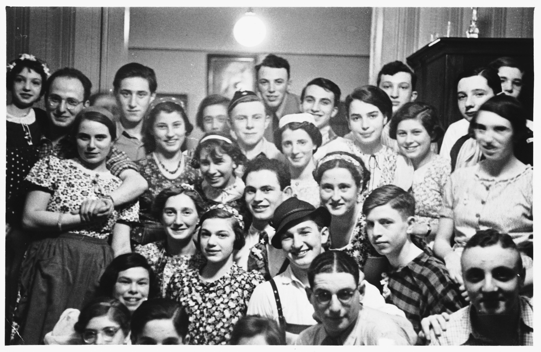 Jewish teenagers attend a Purim party in Frankfurt.  Walter Wolff is pictured in the front row, second from the right.
