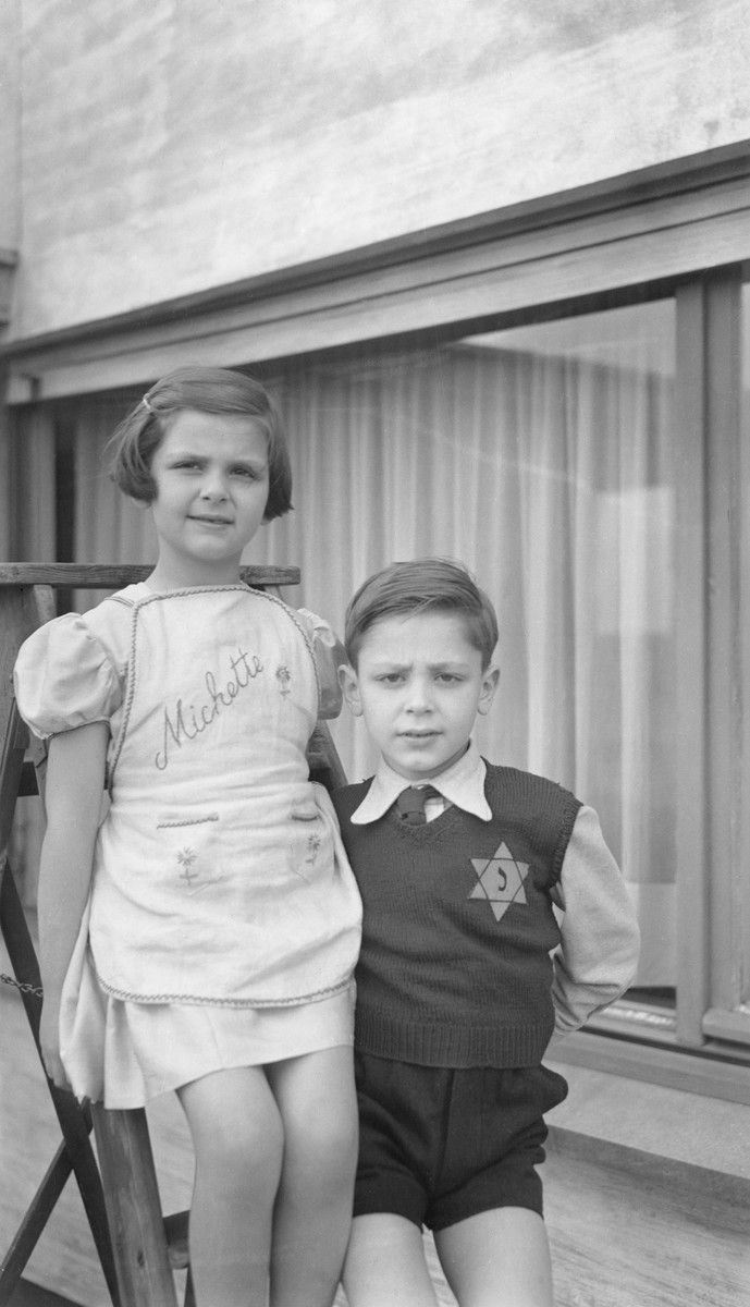 Portrait of two Belgian Jewish siblings, one of whom is wearing a yellow Star of David.  Pictured are Daniel and Myriam Wellner.