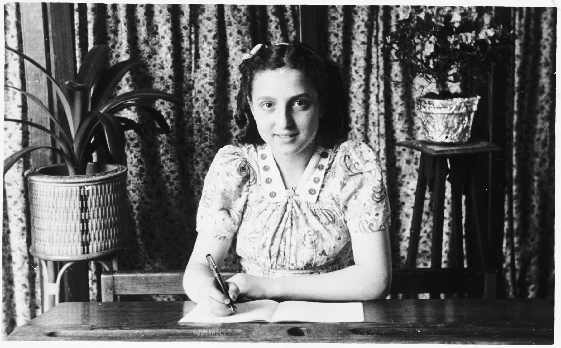 A Jewish girl writes in her notebook while studying at a Catholic school in Brussels soon after the liberation.  Pictured is Flora Mendelowicz.