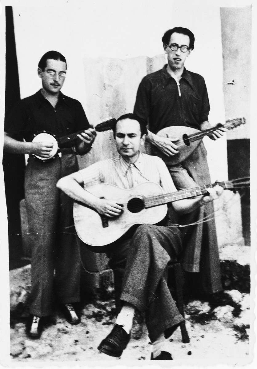 Three internees play stringed instruments in the Campagna internment camp. Walter Wolff is standing on the left.