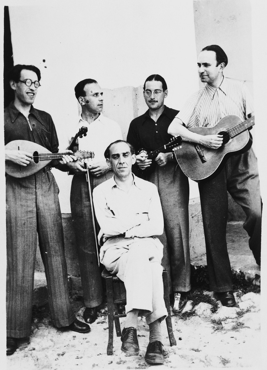 A group of internees play stringed instruments in the Campagna internment camp. Walter Wolff is standing second from the right.