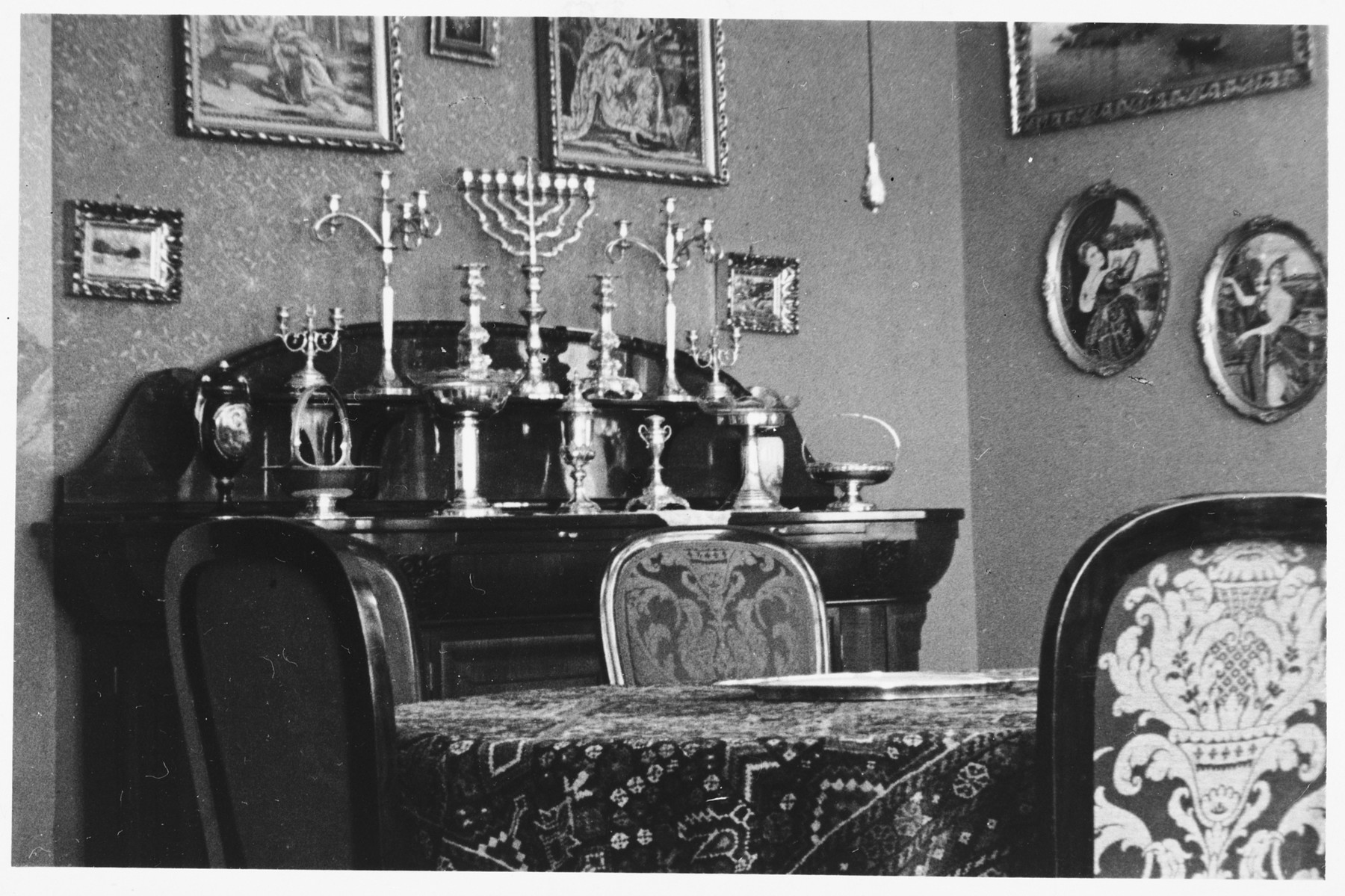 View of the silver religious articles on the dining room buffet in the home of Piroska and Hugo Rosenberger.