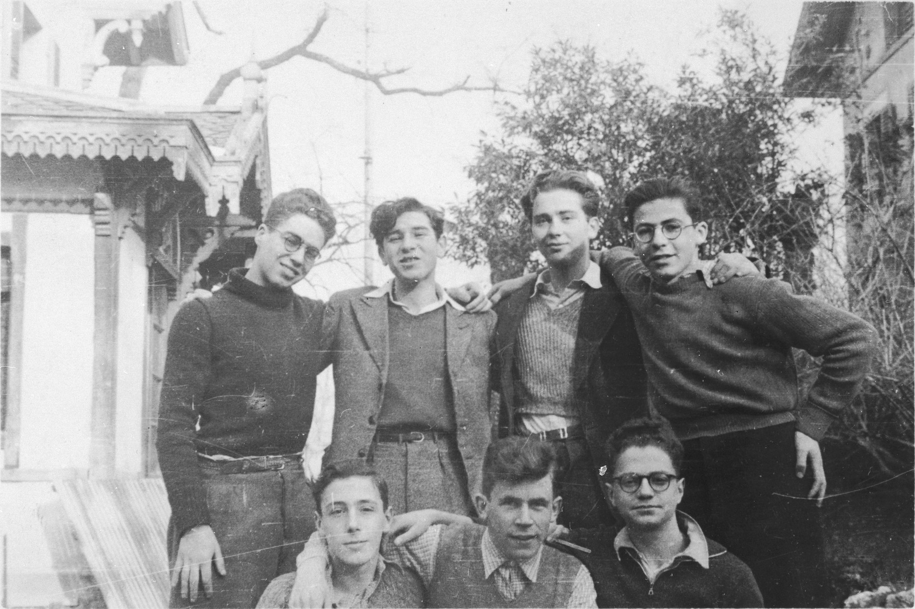 Group portrait of Jewish refugee youth outside the Murailles children's home in Geneva.  Pictured from left to right are: (front row) Alex Alter, Ludwig Mayer and Manfred Filipson; (second row) Kurt Frost, Otto Weiner, Yankel ?, and Theo Brenig.