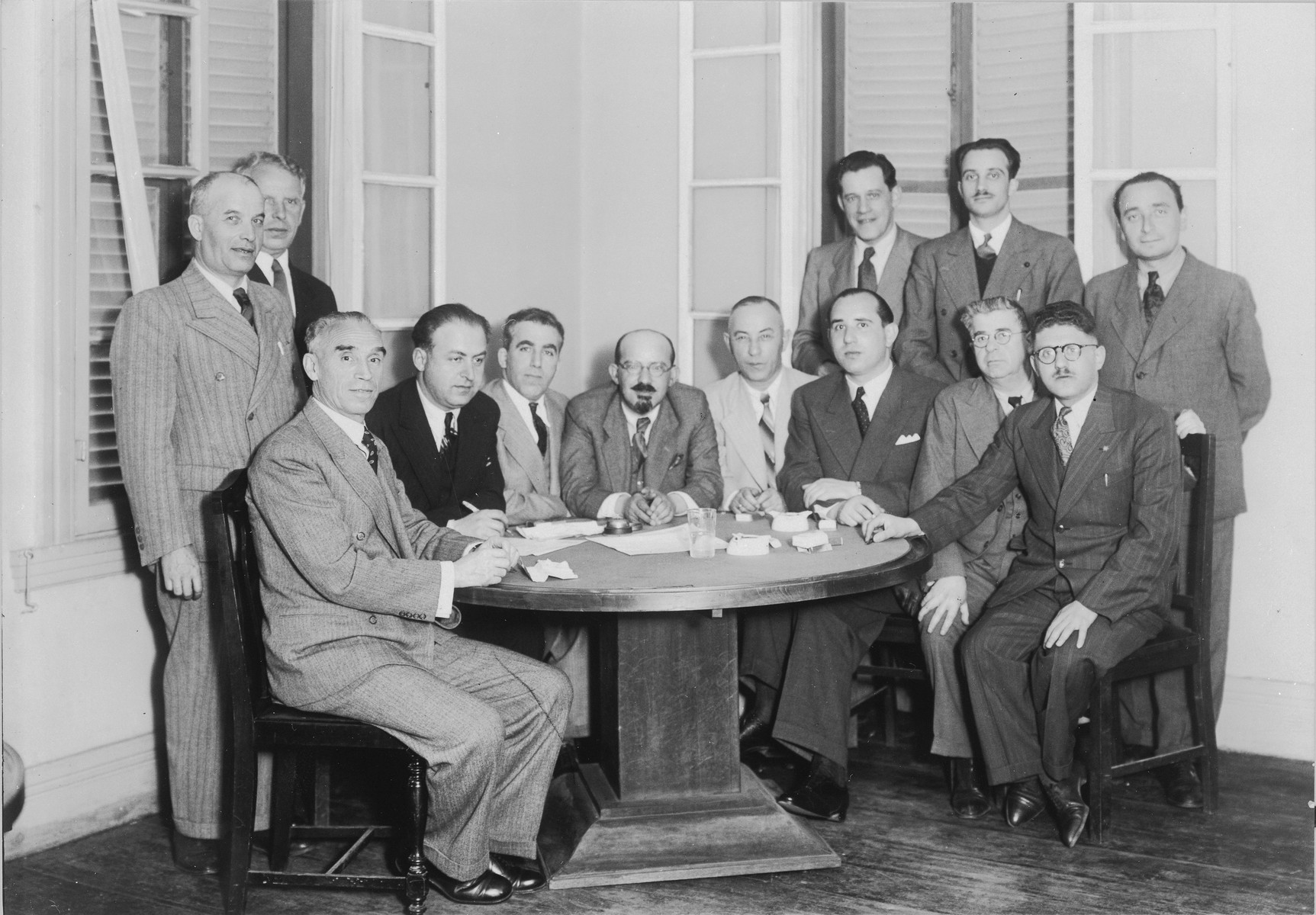 Group photograph of the leadership of the Kobe Jewish community.  Among those pictured are Anatole Ponevejsky (seated third from the left), Moise Moiseeff (fourth from the left), Anatole Ponve (fifth from the left), and Solomon Stolowy (standing, far left).