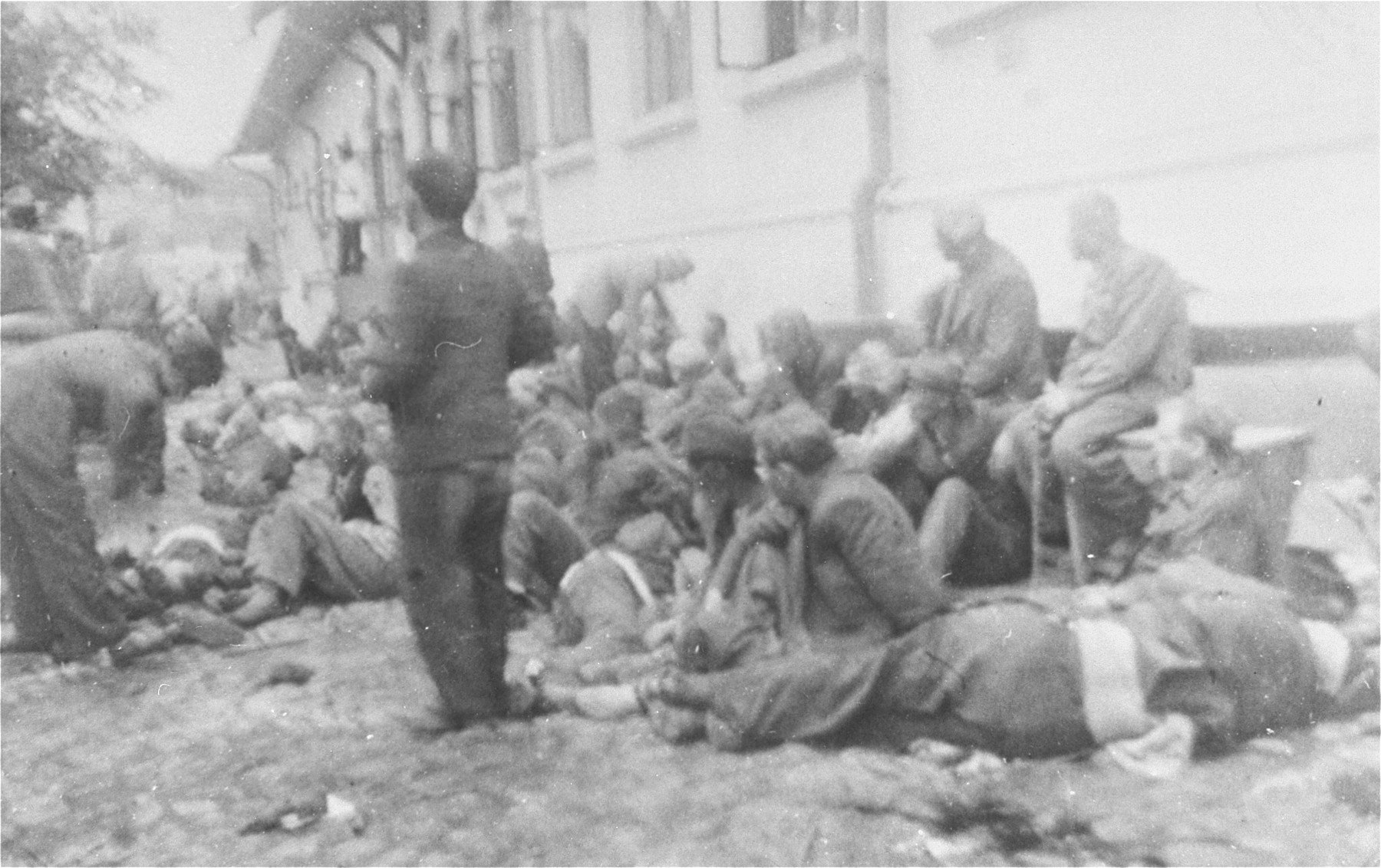 Jews assemble in the courtyard of police headquarters during the Iasi pogrom.