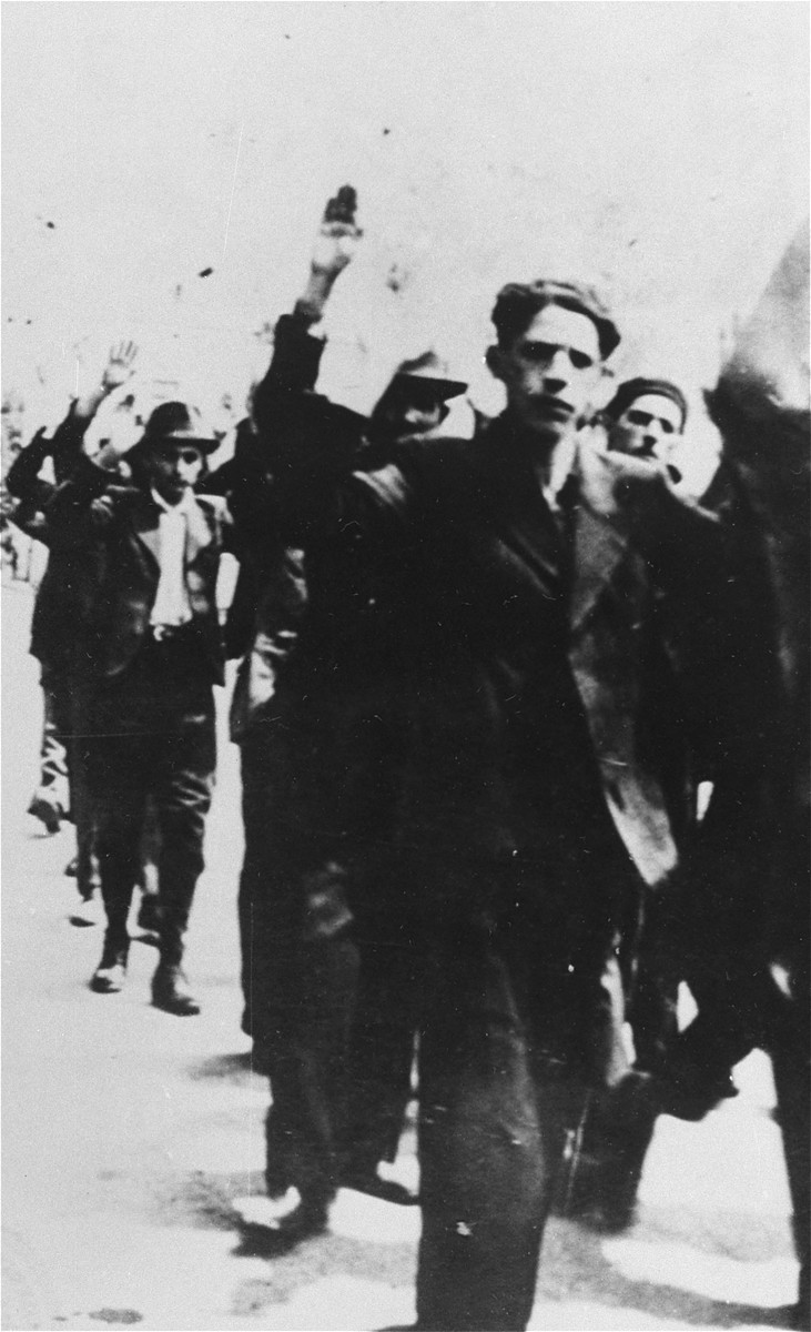 Iasi,June 29, 1941: Arrested Jews being escorted to police headquarters with their hands in the air.
