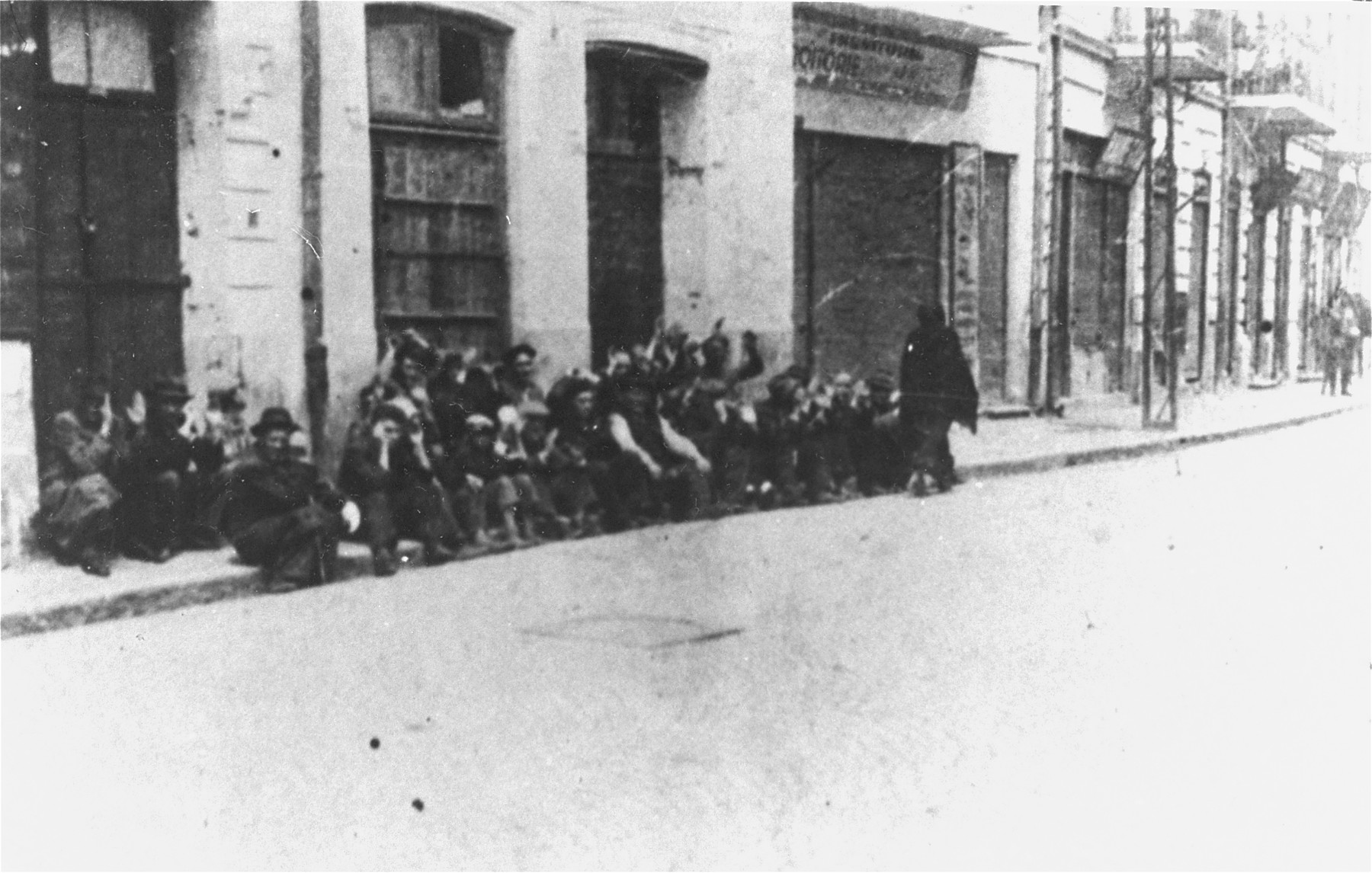 On June 29, 1941, Jews arrested by Romanian soldiers and police wait on a street in Iasi before being sent to police headquarters.
