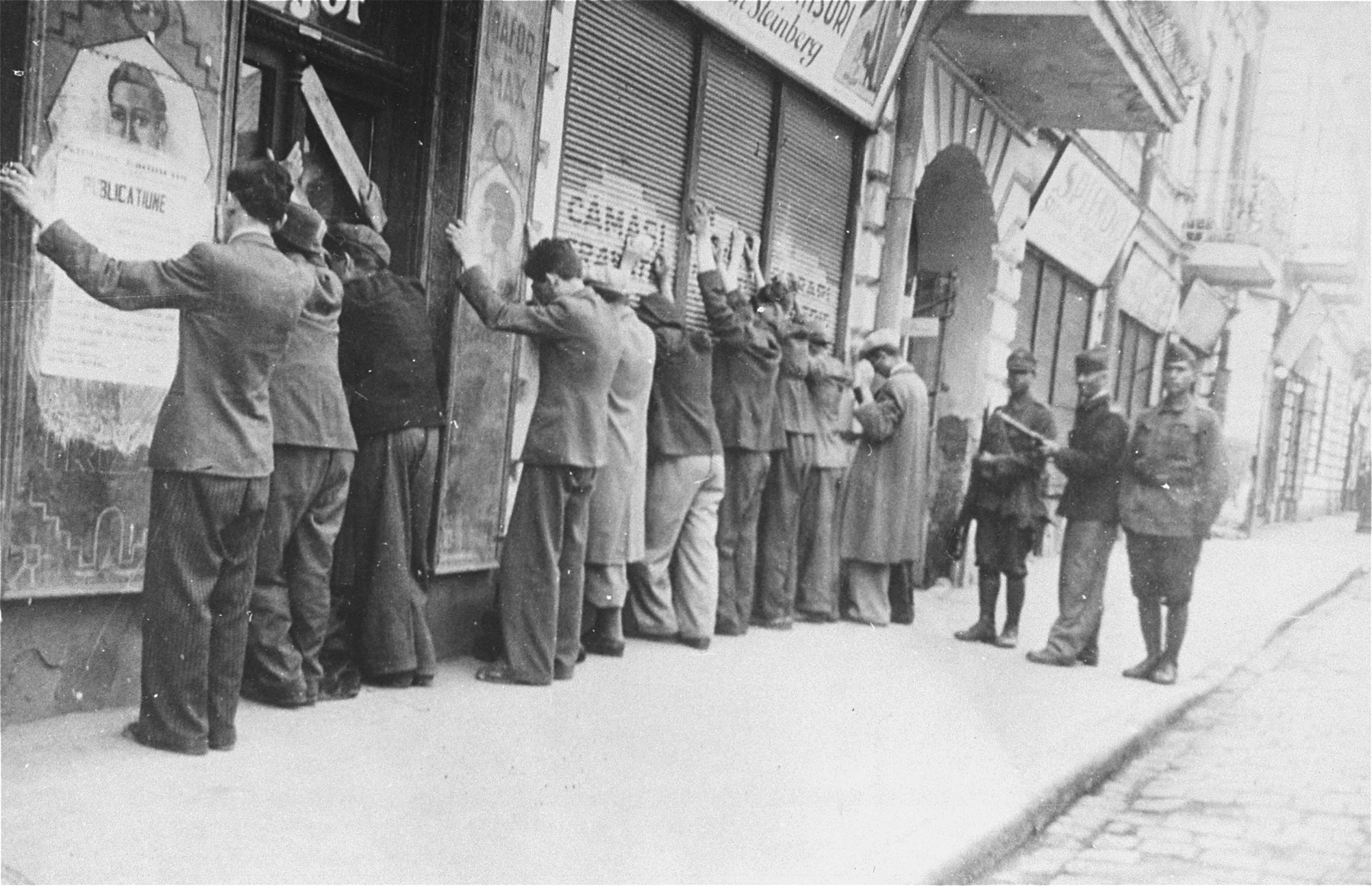 On June 29, 1941, Romanian soldiers and a cadet arrest a group of Jews at 157 I.C. Bratianu Street during the Iasi pogrom.