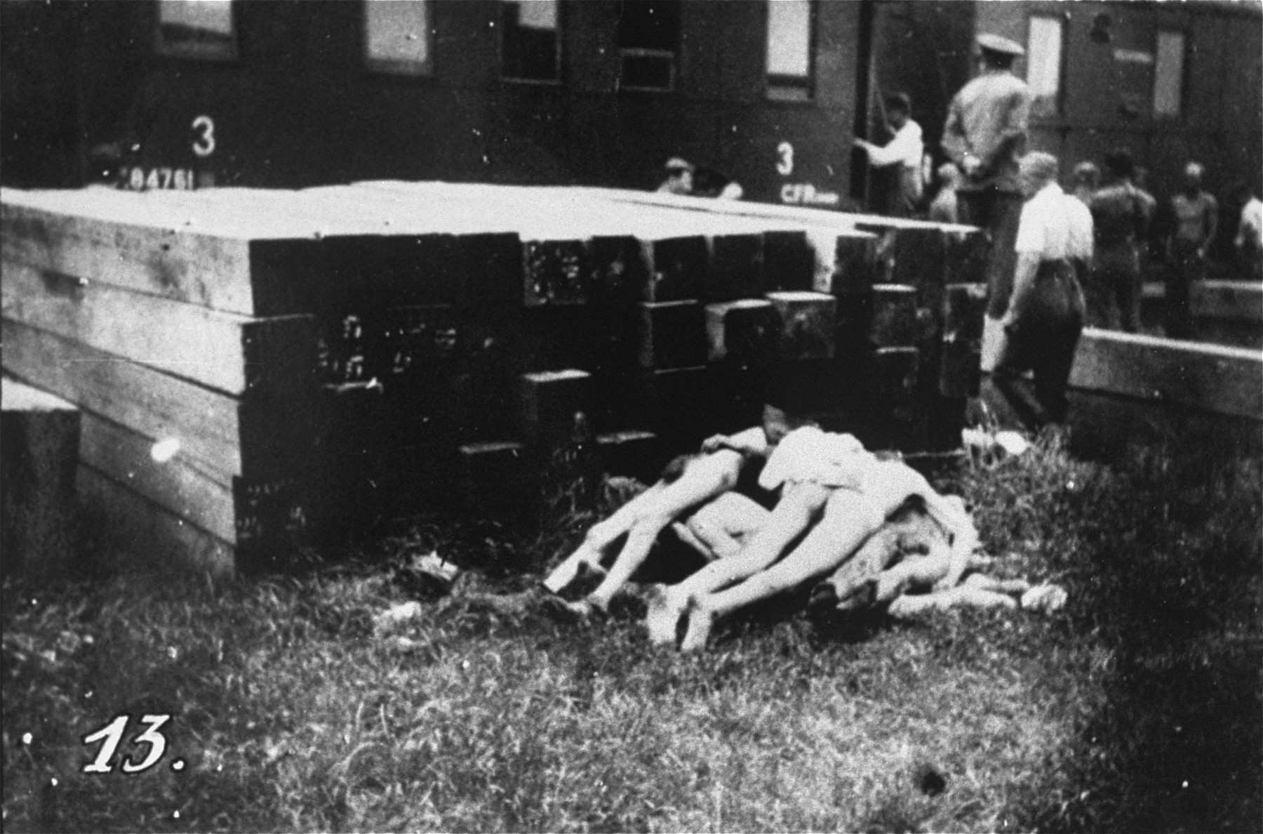 Romanian police and civilians remove corpses from the Iasi death train.