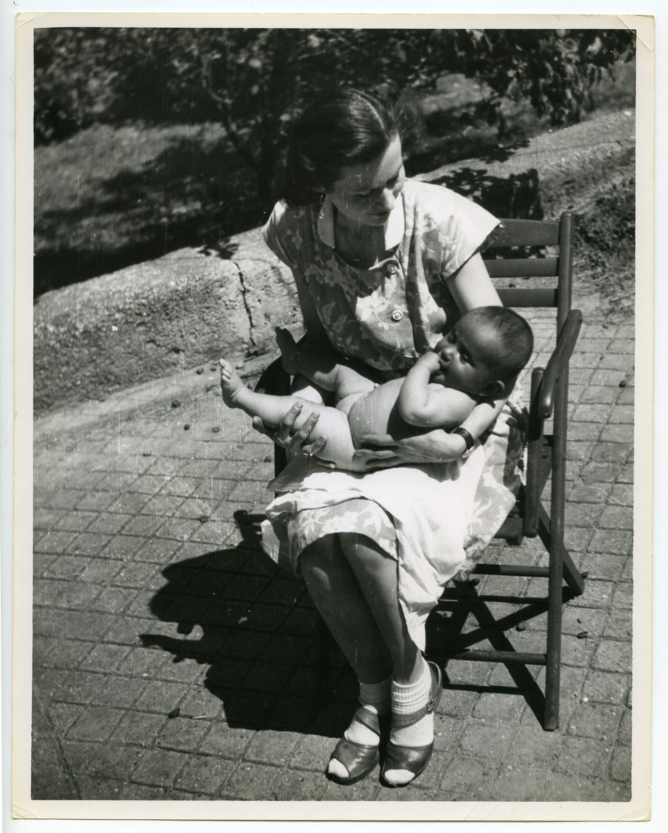 "Close-up portrait of a mother and infant that was used as the cover photograph for a Joint Distribution Committee publication, ""Your Child,"" published in German, French, and Hebrew."