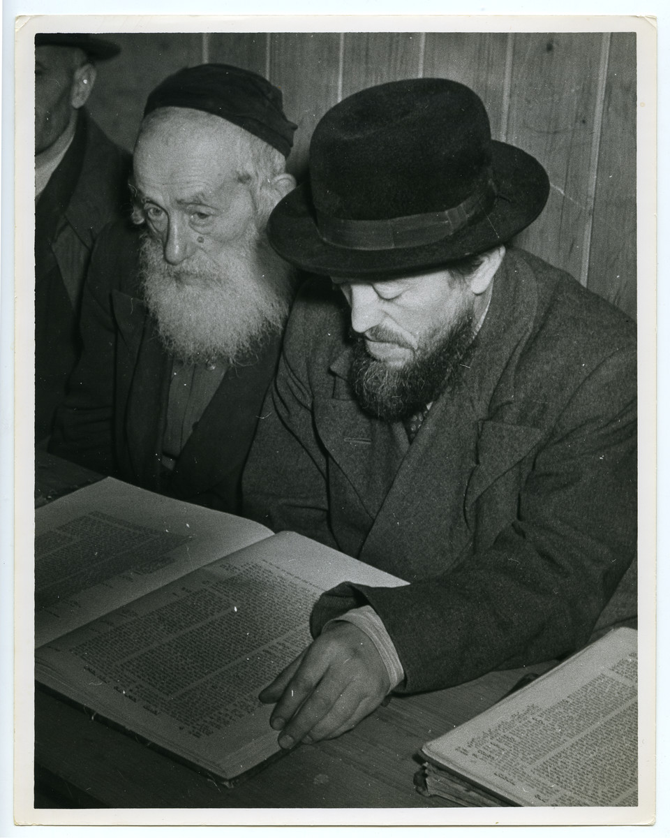 Two Jewish men study Torah in a displaced persons camp [probably in Vienna].