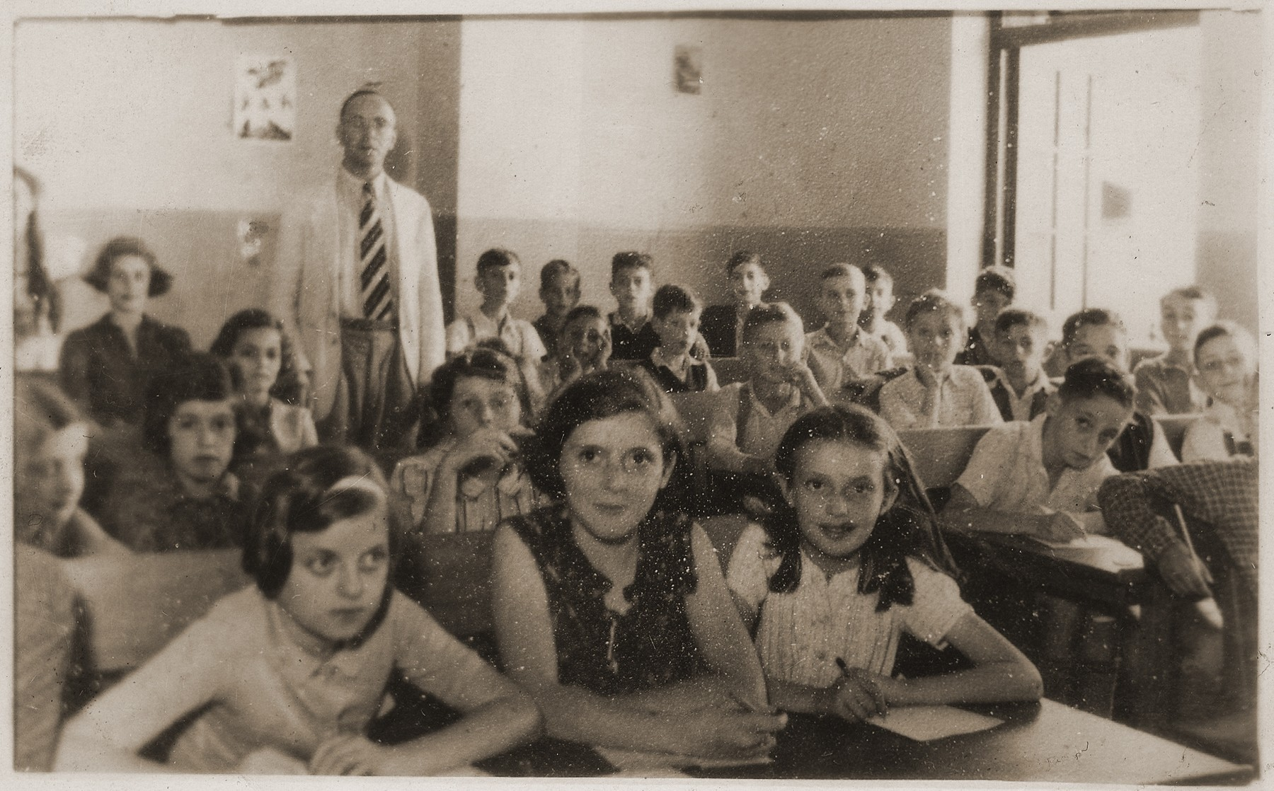 Students in the Hebrew language class at the Transition Upper school on Kinchow Road in Shanghai.    Hannelore Mansbacher is seated in the first row on the left. The teacher in the background is Albert Wessel.