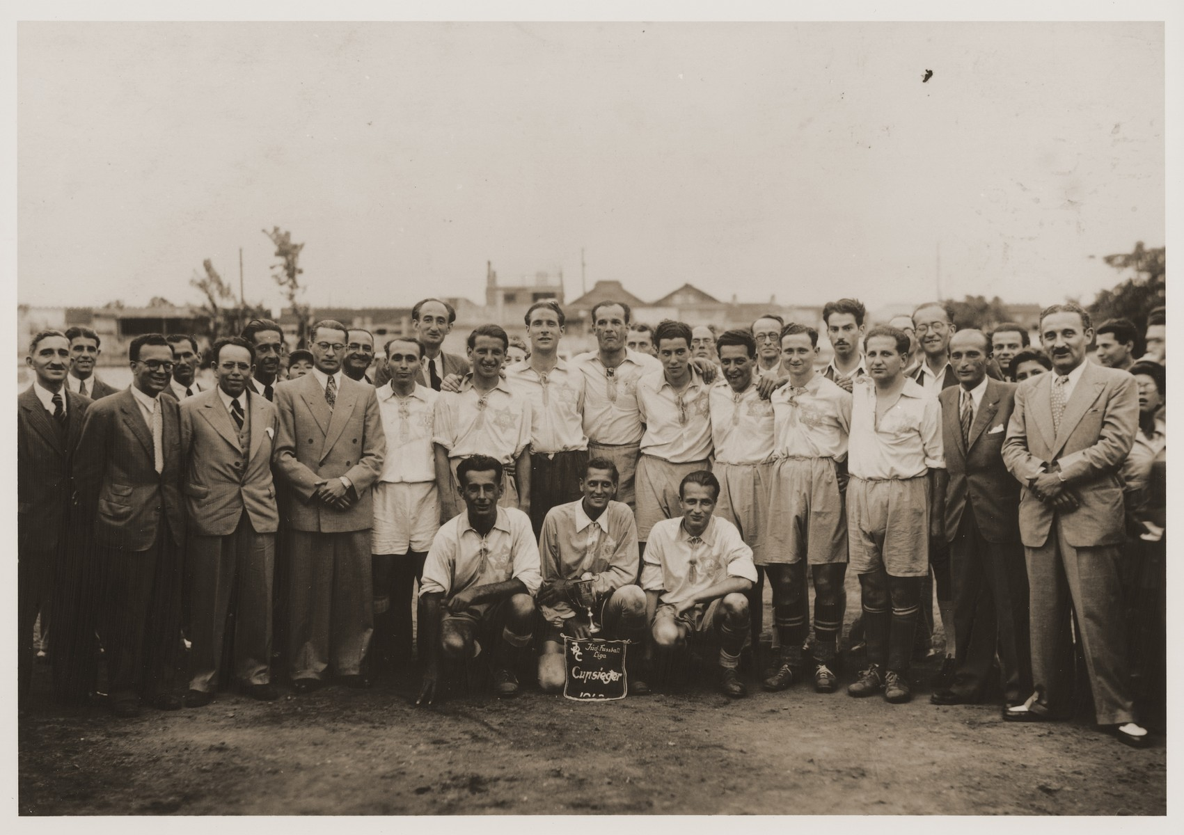 Group portrait of members of the S.J.C soccer team which won the Jewish Refugee Committee of Shanghai championship in 1943.    Eric Goldstaub is kneeling, first on the right.