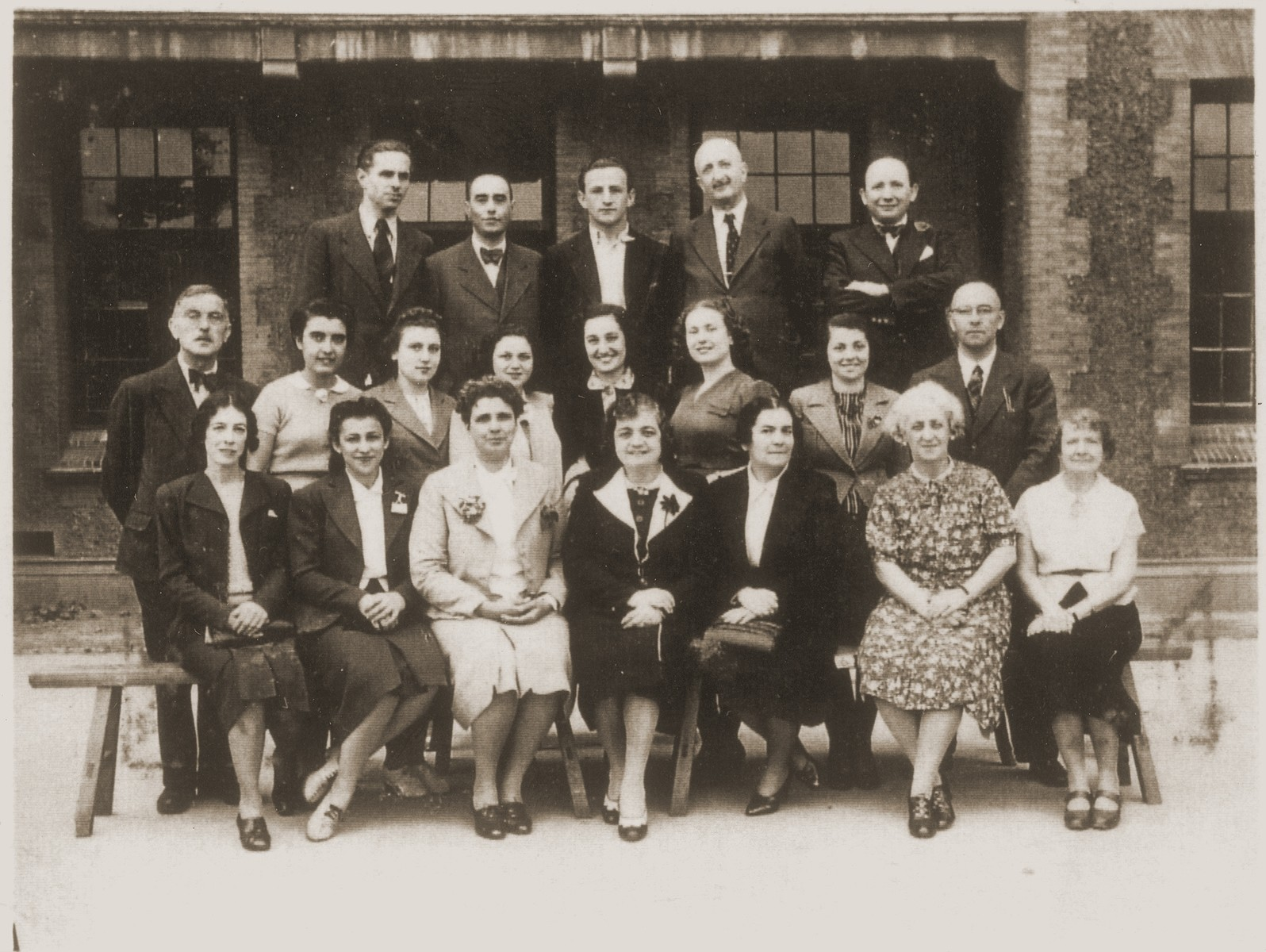 The teaching staff of the Transition Upper school on Kinchow Road in Shanghai.  Pictured from left to right are bottom row: ?, Ms. Hanin, ?, Mrs. Hartwich (school principal), ?, Mrs. Lebrun, Mrs. Plohn (kindergarten teacher); middle row: Mr. Epstein, Ms. Sussman (school secretary), Ms. Oystragh, Ms. Brussels, ?, Ms. Manassee (kindergarten teacher), Mr. Albert Wesel (Hebrew teacher); top row: Mr. Scherman (art teacher), Mr. Plaschke, Leo Meyer (gym teacher), Dr. Solomon (school physician), Mr. Erdstein (dance teacher).