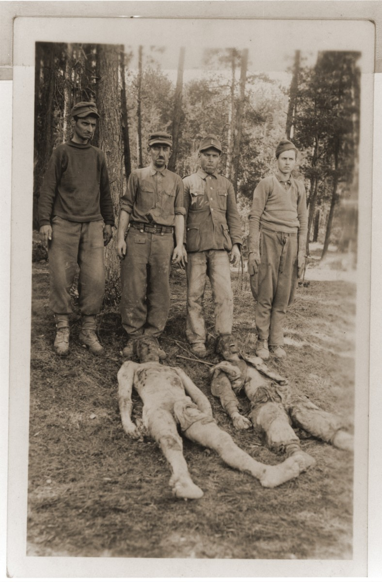 German soldiers stand behind the corpses they exhumed from a mass grave in Czechoslovakia.