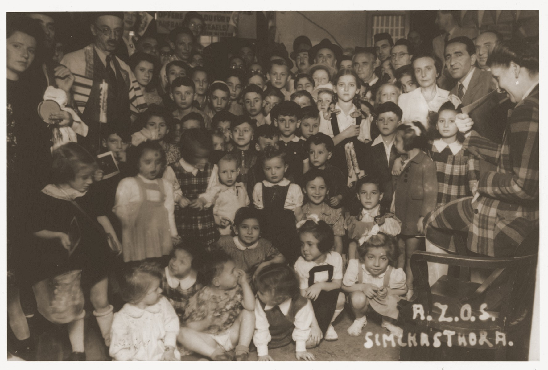 Students celebrate Simhat Torah at the A.Z.O.S. school in Shanghai.    Harry Fiedler is pictured standing in front of the teacher in the white blouse.