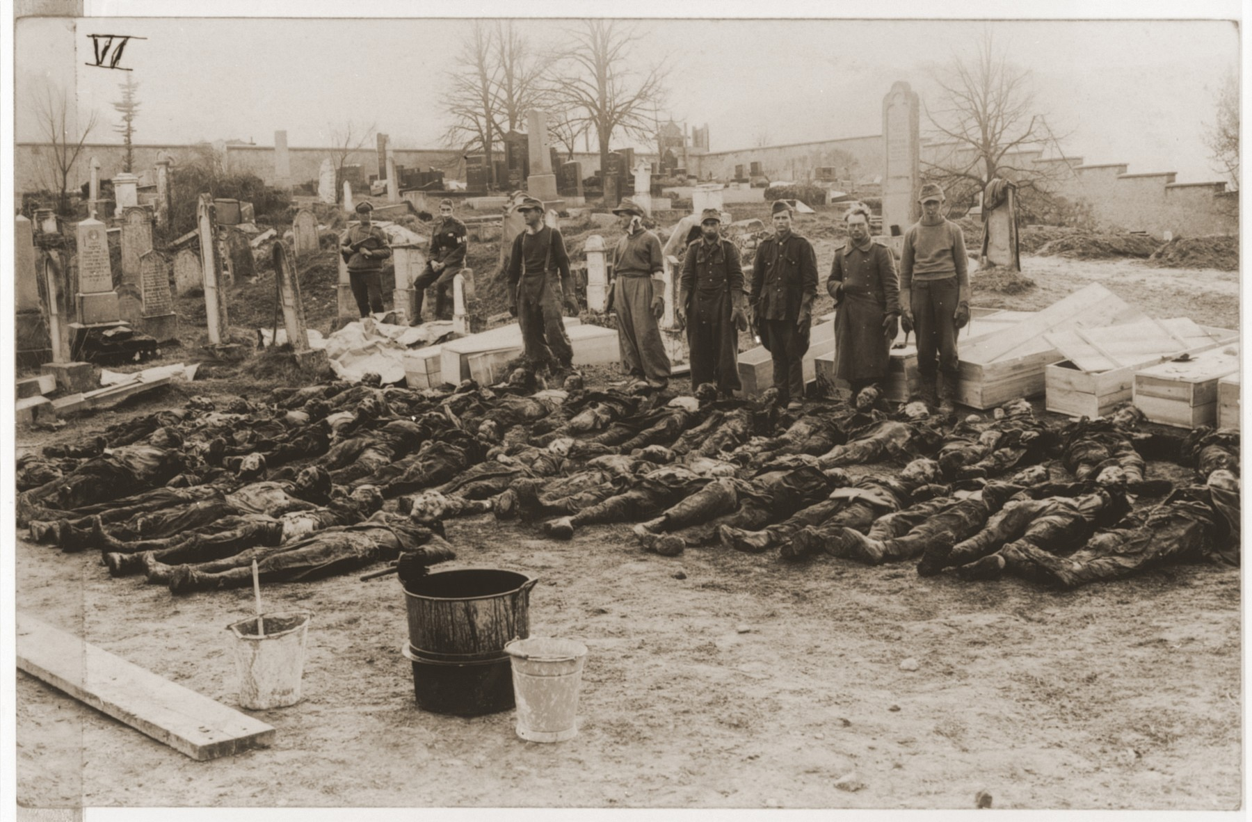 German POW's are forced by Soviet guards to rebury corpses exhumed from a mass grave in Czechoslovakia.