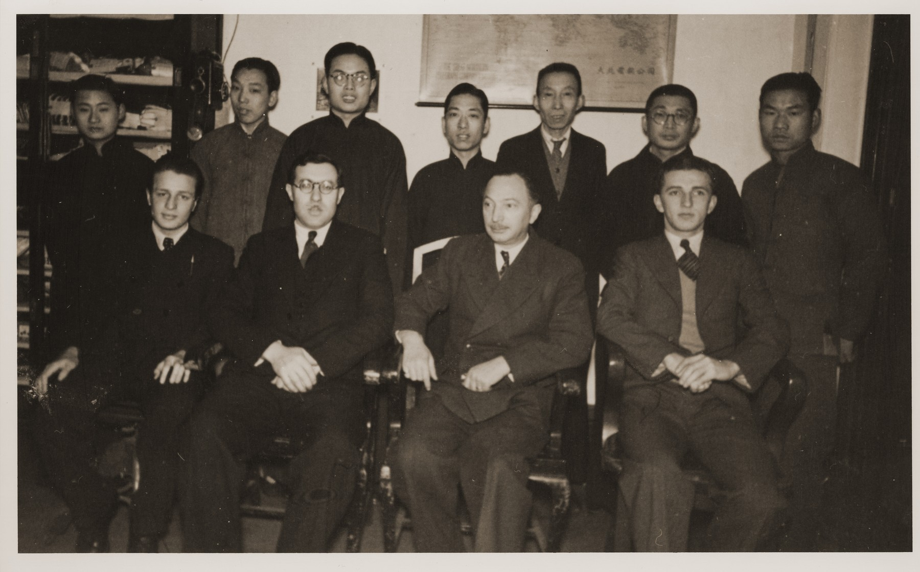 Group portrait of the staff of the International Committee for European Immigrants in China.  Paul Komor is seated second from the right; Eric Goldstaub is seated first on the left.