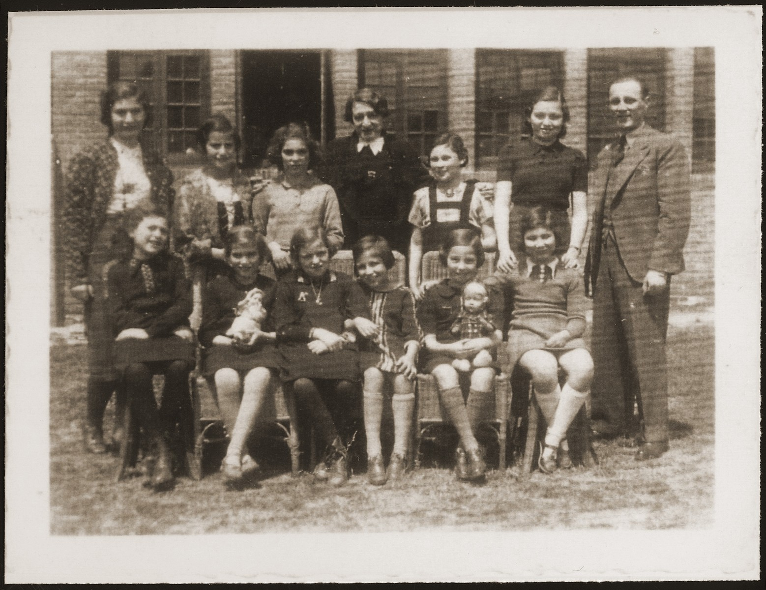 A school class of Jewish refugee children, including Hannelore Mansbacher (seated 1st row, third from left), at Transition Upper school on Kinchow Road in Shanghai.