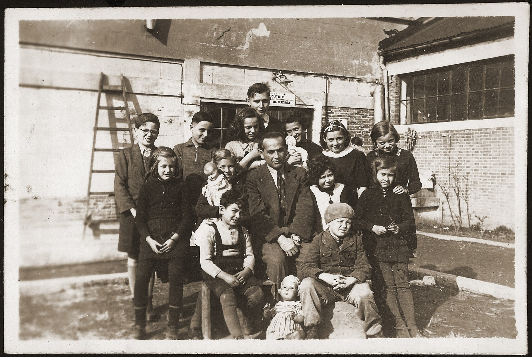 A class of Jewish refugee children in the Pingliang refugee camp near Shanghai.  On the right in the back row is Hannelore Mansbacher (now Hannah Weill).