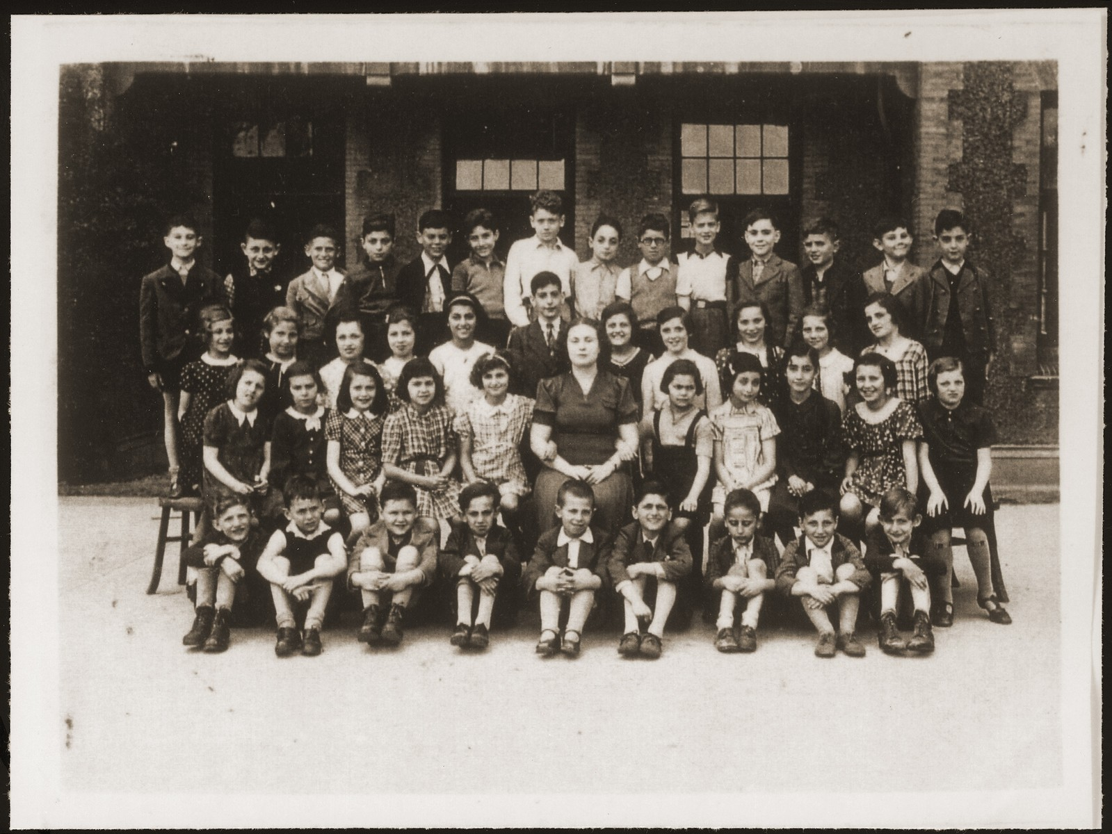 A school class of Jewish refugee children, including Hannelore Mansbacher (seated 2nd row, on the end at far right), at Transition Upper school on Kinchow Road in Shanghai.