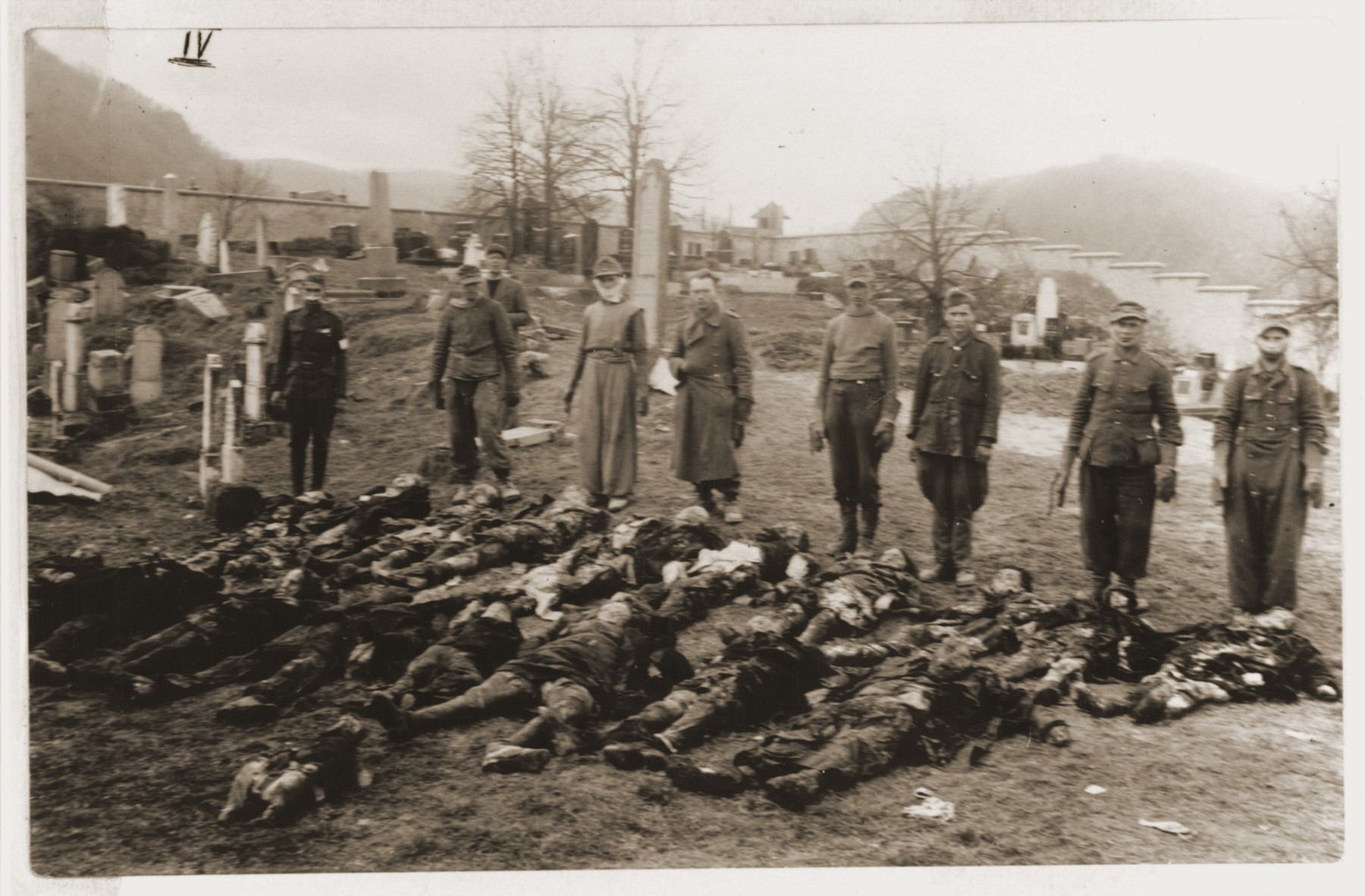 German POW's are forced to rebury corpses exhumed from a mass grave in Czechoslovakia.