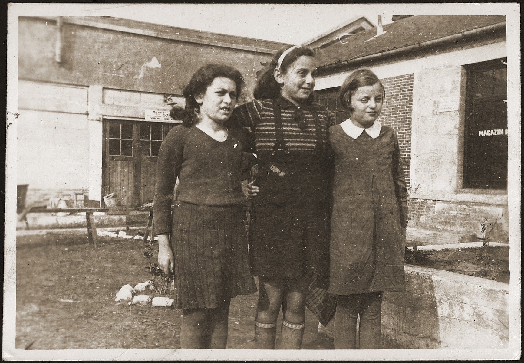 Three Jewish girls pose in the Pingliang refugee camp.  Hannelore Mansbacher is on the right, and her friend Rita (middle) is in the middle.