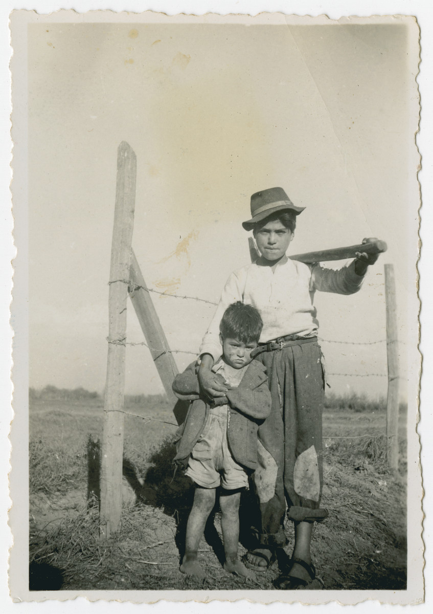 "Photograph from an album entitled, ""Hacshara Kidma Chile,""  documenting life on a postwar Shomer Hatzair Zionist agricultural collective in Chile.  Two young Chileans pose by a barbed-wire fence.  The inscription on back (in Spanish) reads, ""Manolo and Enrique."""