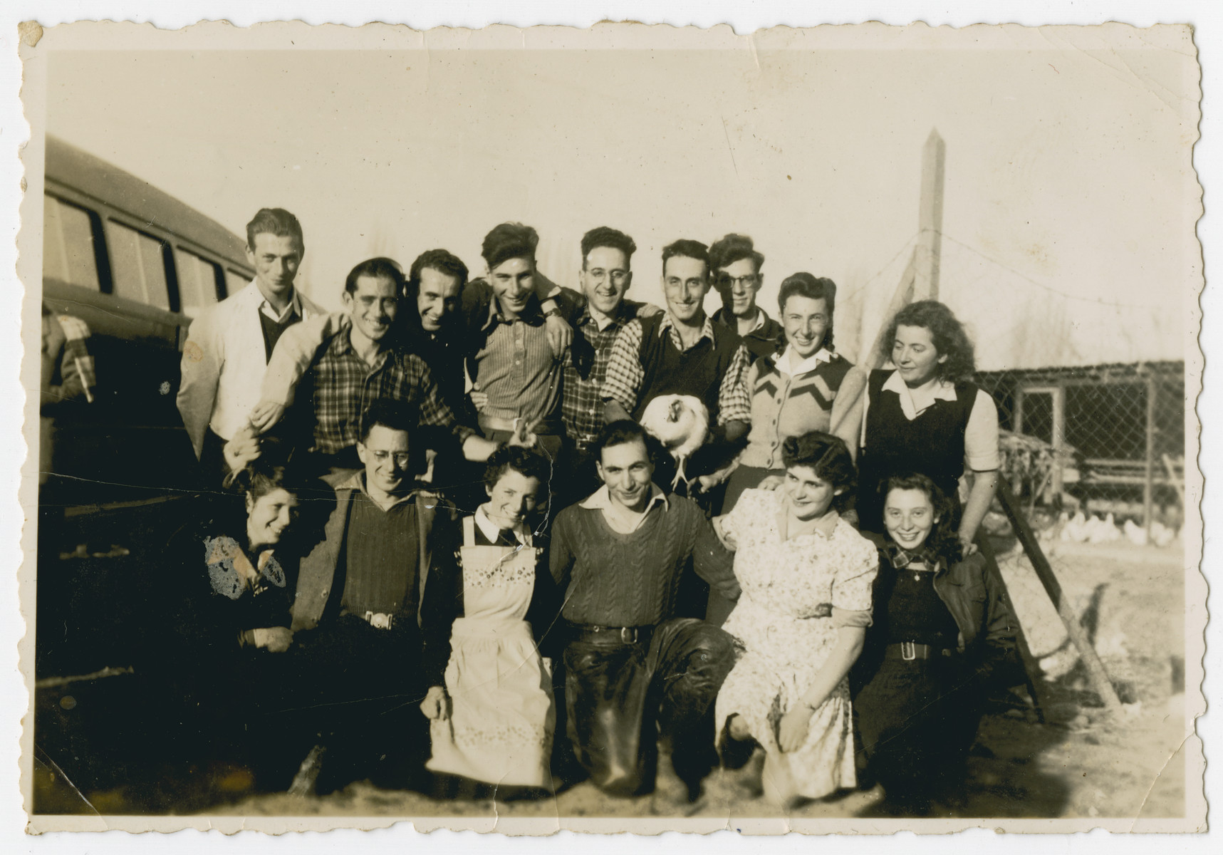 """Photograph from an album entitled, """"Hacshara Kidma Chile,""""  documenting life on a postwar Shomer Hatzair Zionist agricultural collective in Chile.  A group of young adults stops for a photo while traveling by bus to the haschara. The inscription on the back (in German) reads, """"Trip to the Hachshara.""""  The inscription on the album page (in Spanish) reads, """"The first Jalutzim [pioneers]....""""  Among those pictured are Susi Hirschberg, Hanni Bloch, Finola (?) Muller, Ballo, Carlos Mayer, Manfred Flat, Sallo Asner (?), Hanus Ehrlich (?), Ernst Joel, Ruth Klein, Marion Jokolsh (?), Hans Hoffstatt (?), Ramona Lorn (?), Meck Krotosch, Eva Frankel."""
