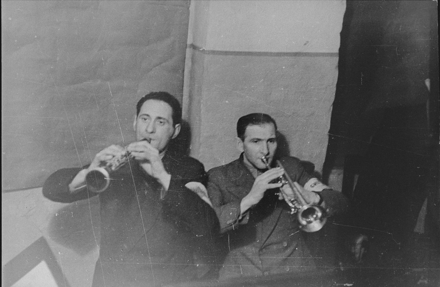 Performance by two members of the Kovno ghetto orchestra.  Pictured are Yerachmiel Wolfberg and Yitzhak Borstein.