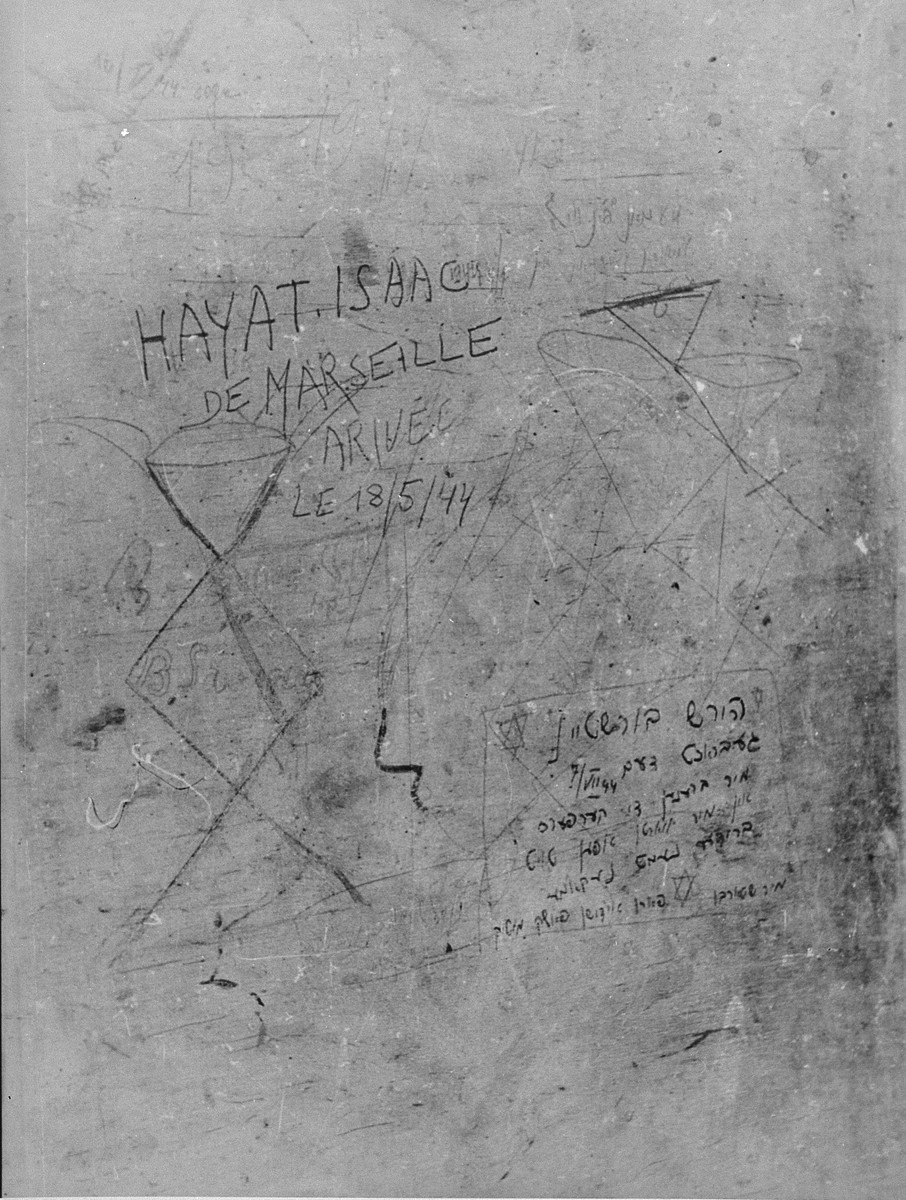 "Messages scrawled by Jewish prisoners on a wall inside Fort IX, shortly before their execution.  George Kadish photographed the writings on the walls of the prison after liberation. One message reads: ""Hirsh Burstein was brought here July 7, 44.  We are burning bodies and awaiting death.  Brothers, Revenge!  We are dying courageously for the people.""   Another inscription reads ""Hayat Isaac from Marseille, arrived May 18, 1944."""
