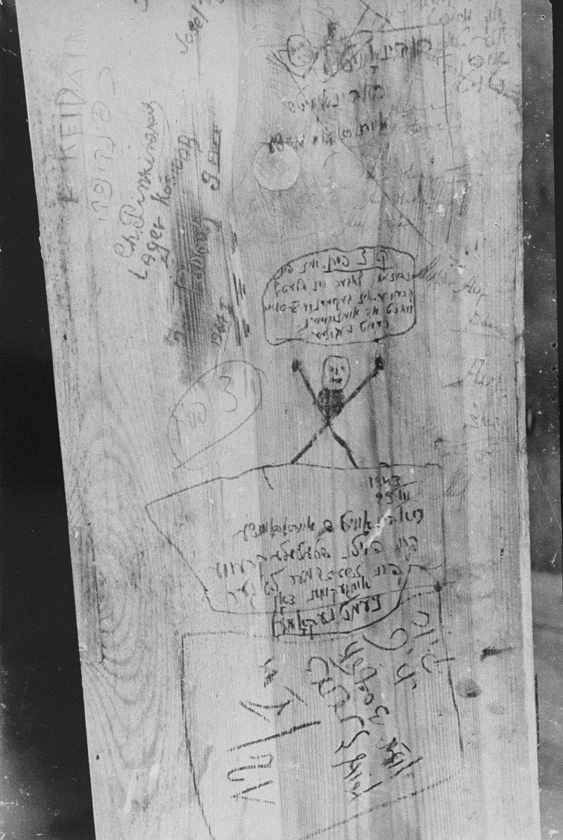 "Messages scrawled by Jewish prisoners on a wall inside Fort IX, shortly before their execution.  George Kadish photographed the writings on the walls of the prison after liberation.  One of the messages reads: ""On July 4th, 84 men were brought from Vilna; 60 were killed right away (shot) and burned, 82 were shot later."""