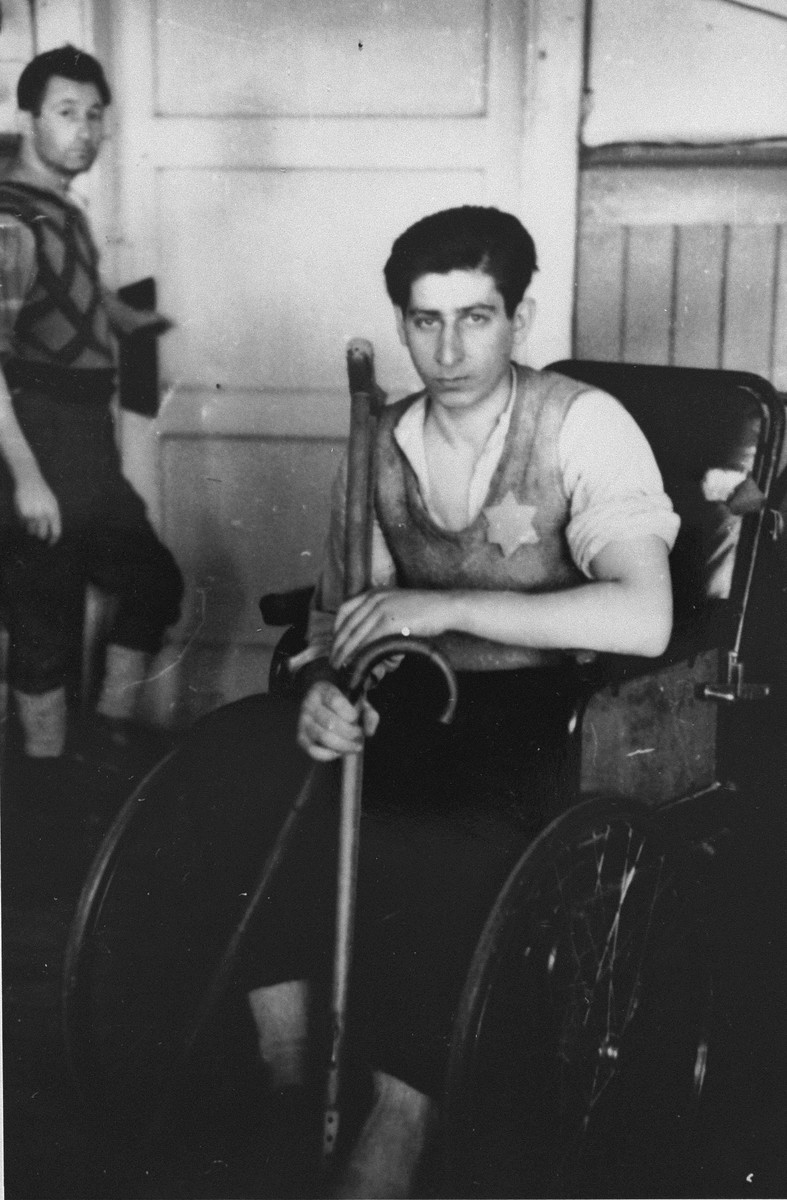 A handicapped youth sitting in a wheelchair.