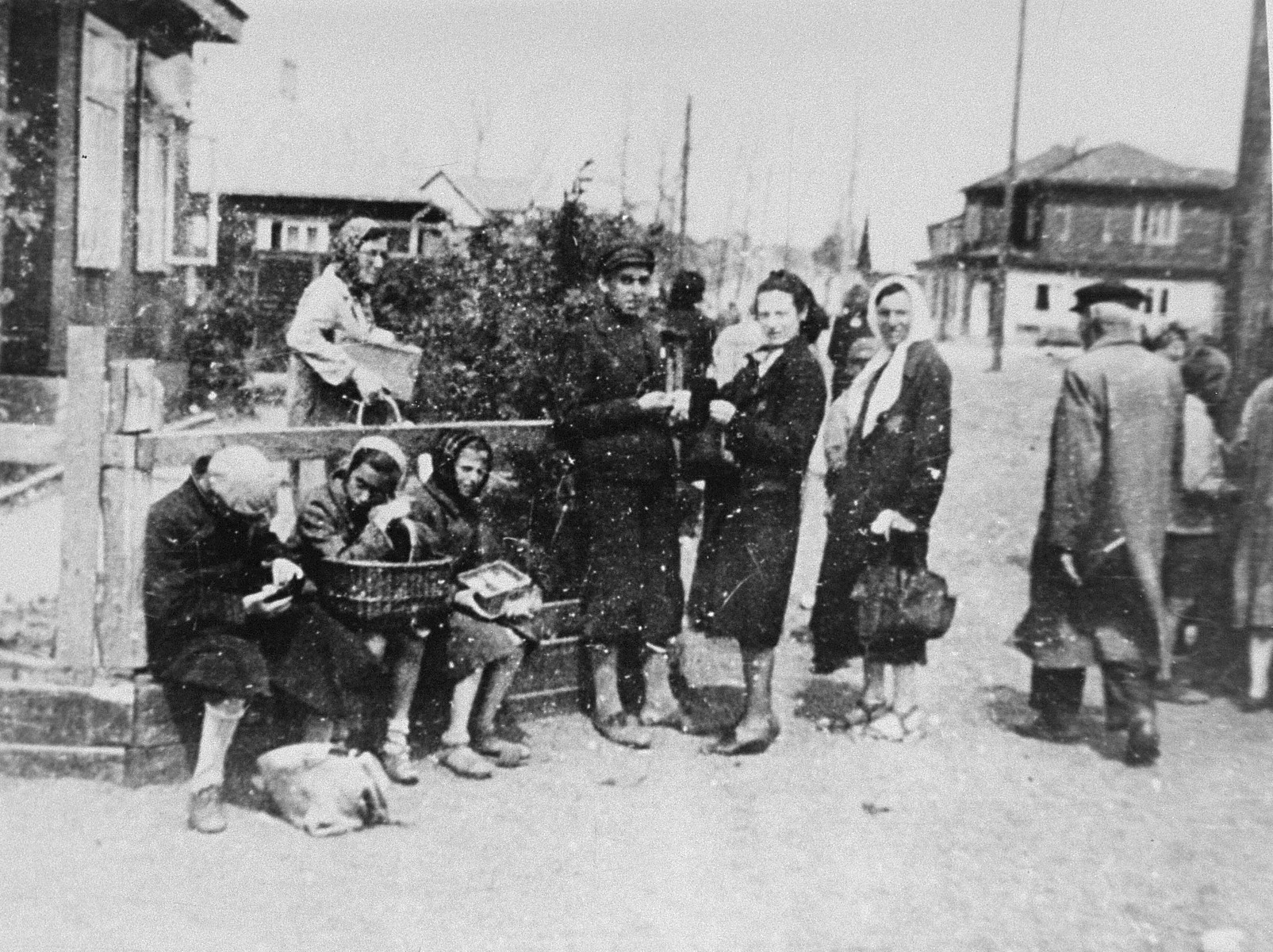 A group of Jewish women are gathered near the market square in the Kovno ghetto.