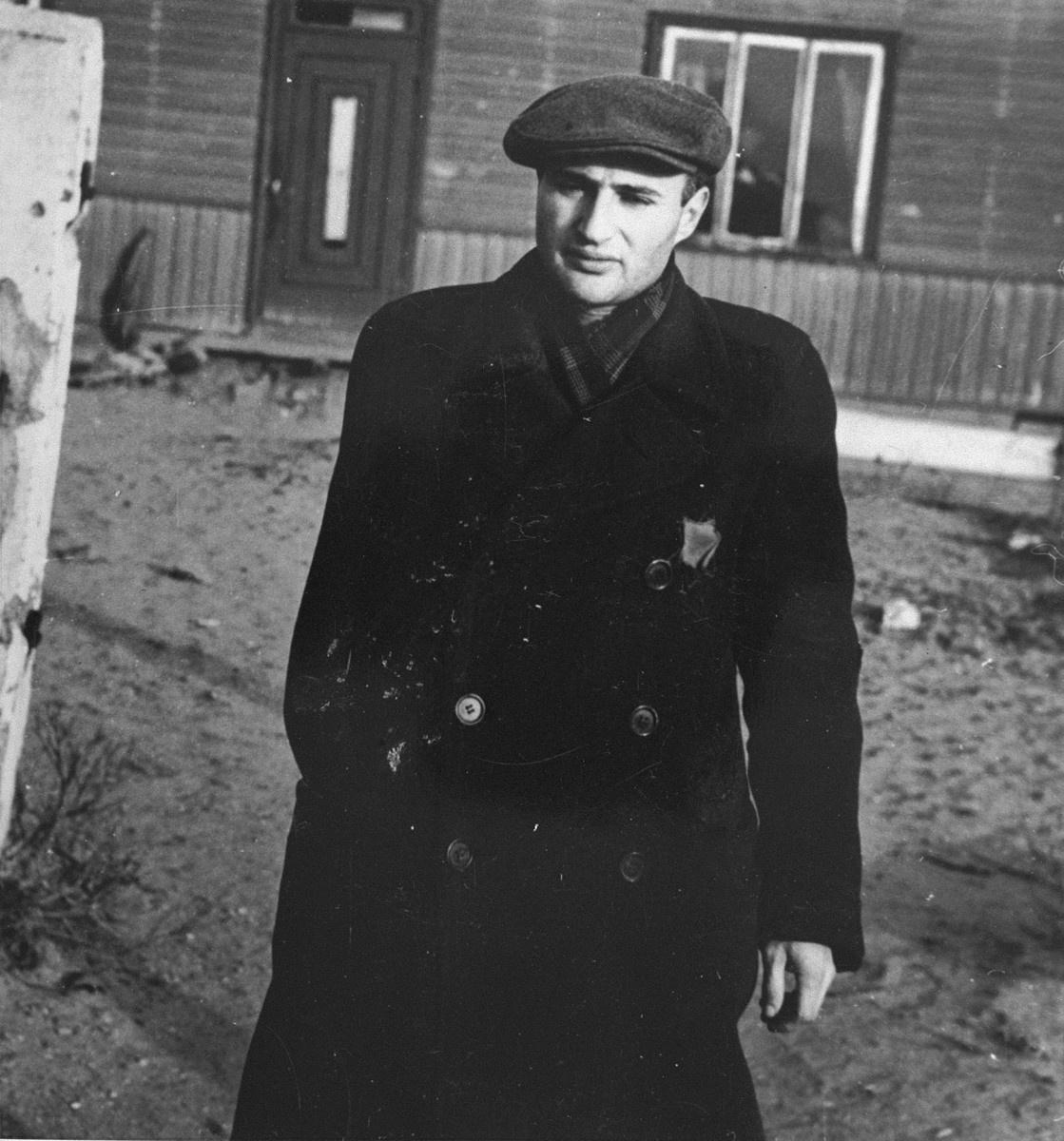 Portrait of Noah Strauss in the Kovno Ghetto.  Before the war, Noah was a clerk in the Central Bank of Kovno.  During the Slobodka pogroms in June 1941, Lithuanian partisans fired shots into his home.  His mother Yentl was killed, and Noah lost his left arm.  In June 1944, Noah was deported to Dachau where he perished shortly before liberation.