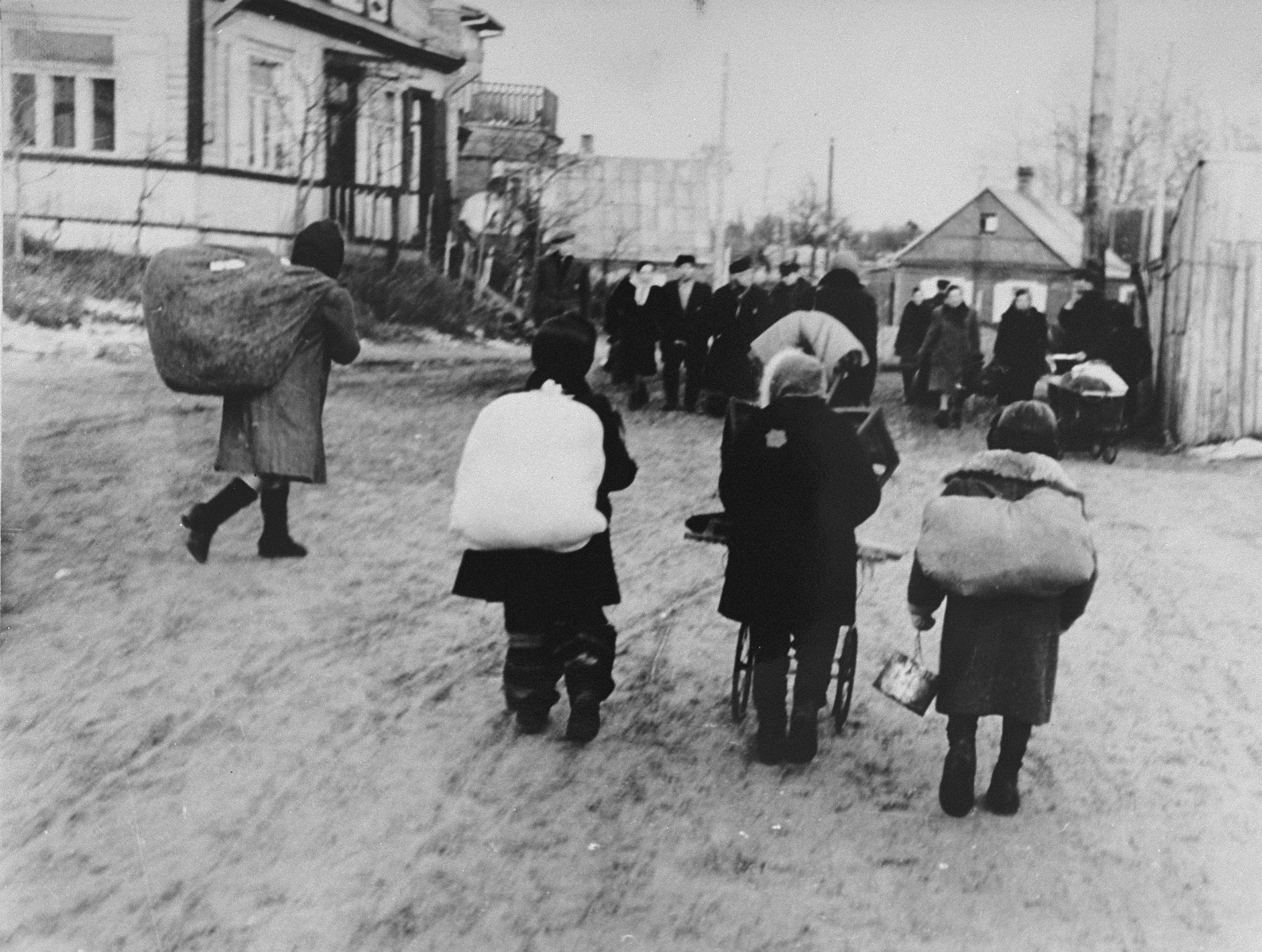 Jews move their household possessions to new quarters following the Small Ghetto Action of October 4, 1941.