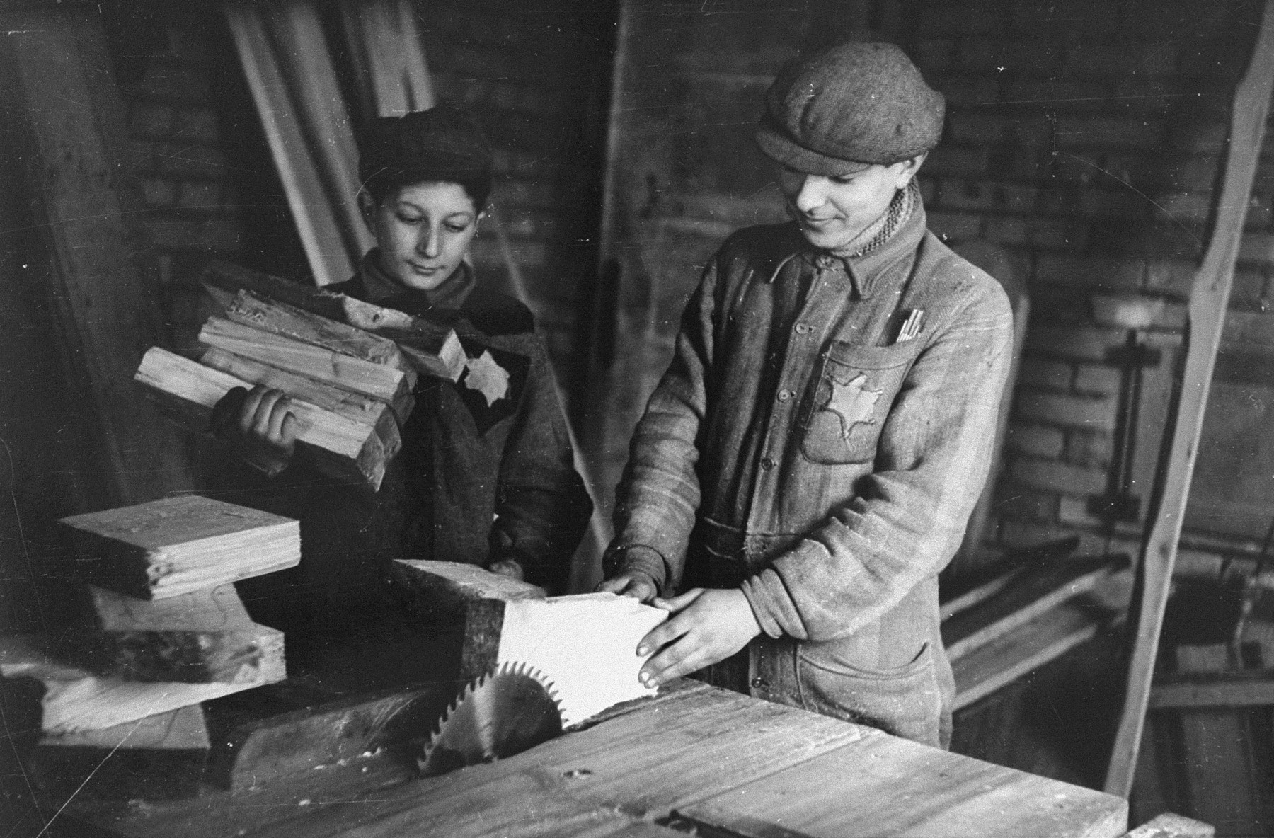 Two youths working in a woodworking shop in the Kovno ghetto.    Pictured at the left is Daniel Bursztyn, son of the Yiddish writer Michal Bursztyn.